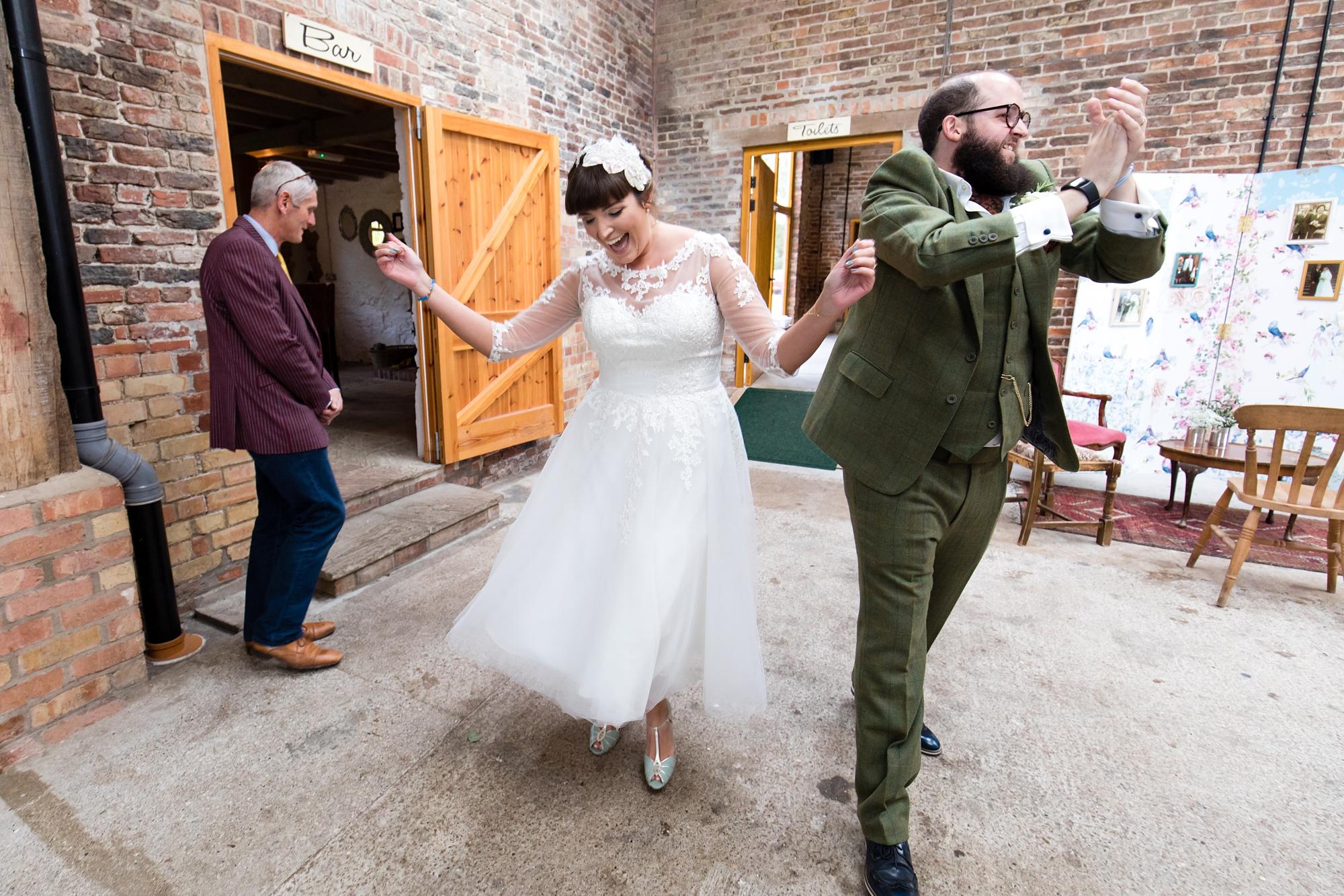 York Wedding Photography at Barmbyfield Barns bride & groom entrance