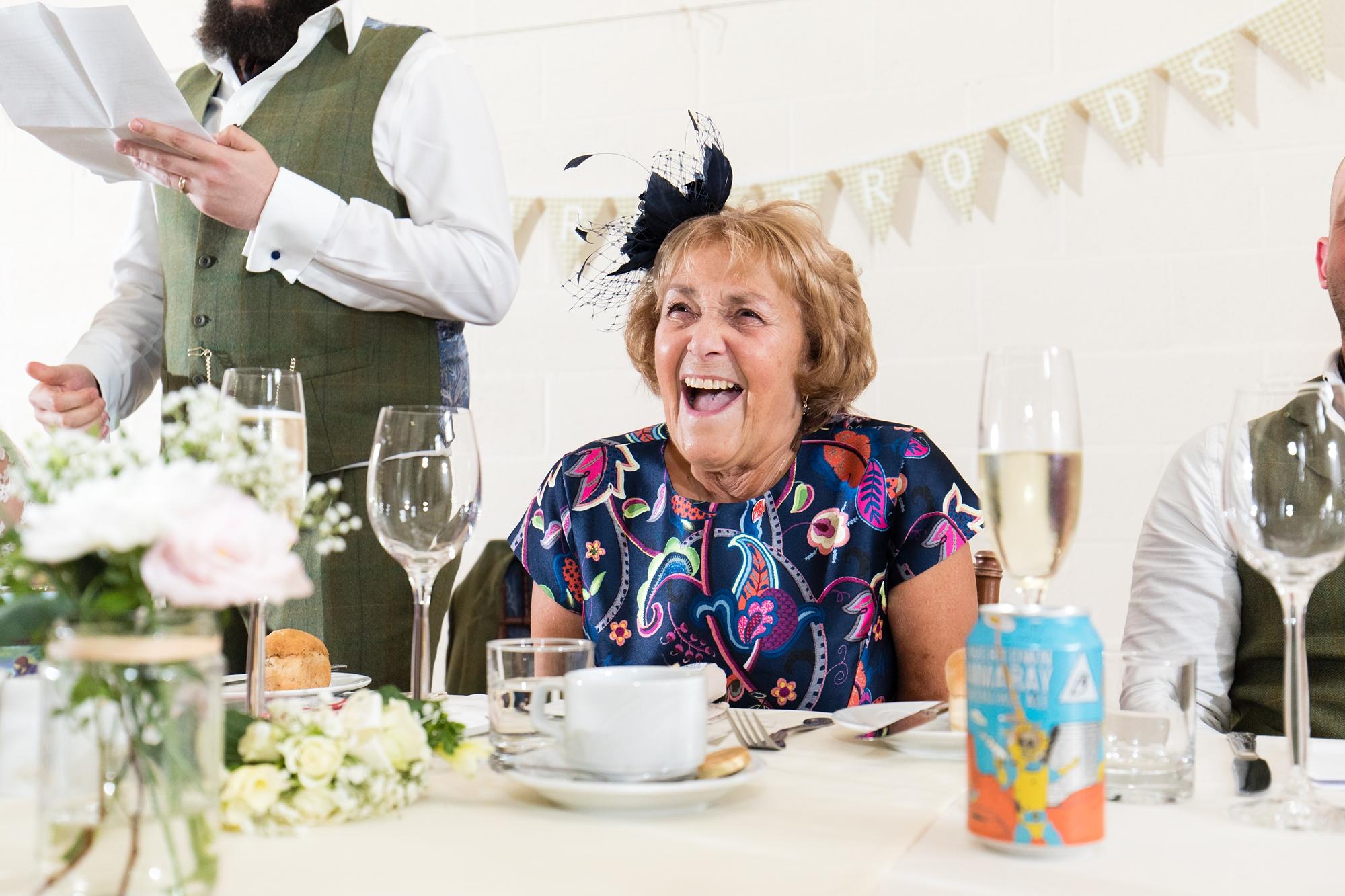 Groom's mum laughing during speeches
