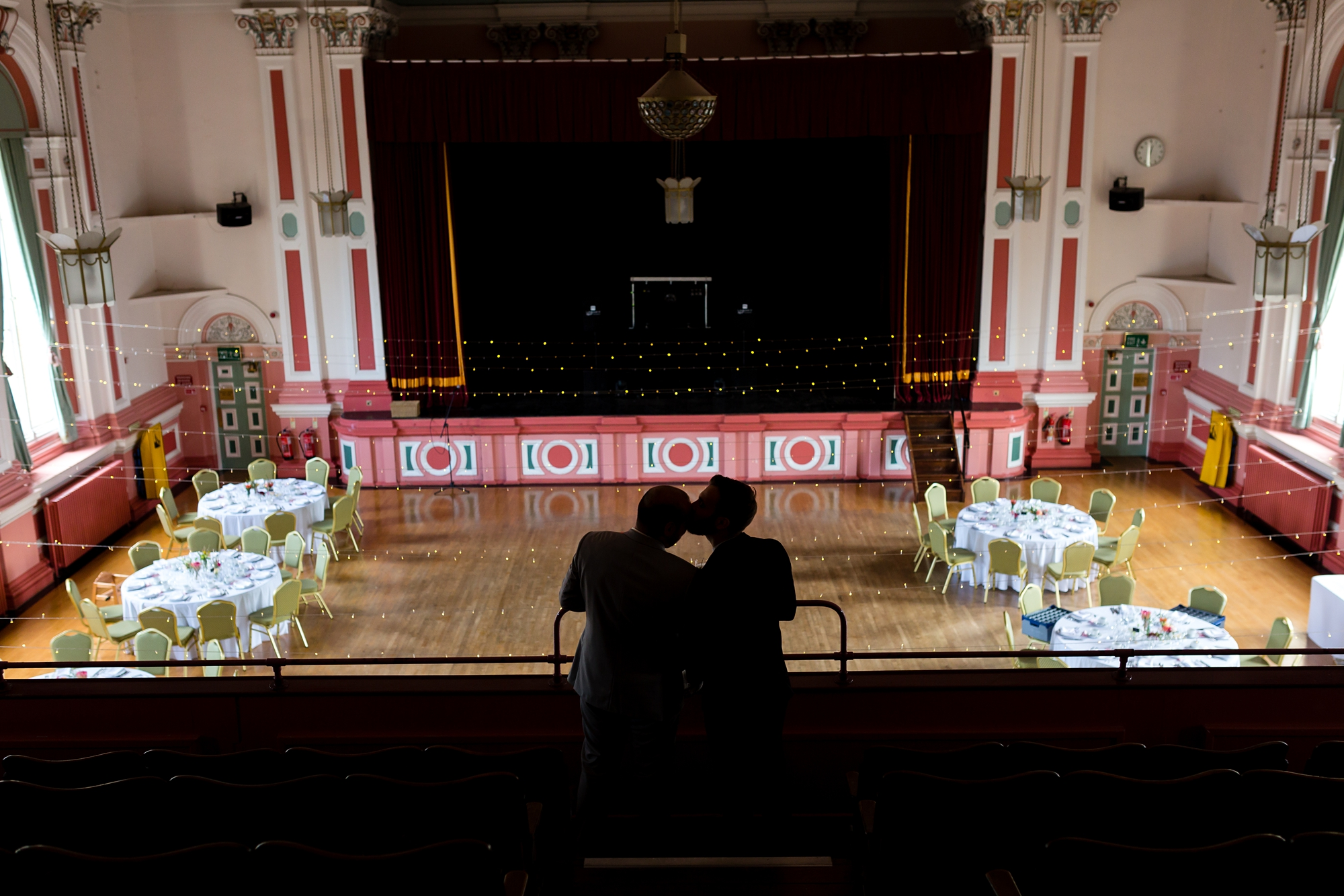 Silhouette of groom's kissing at Victoria Hall Saltaire