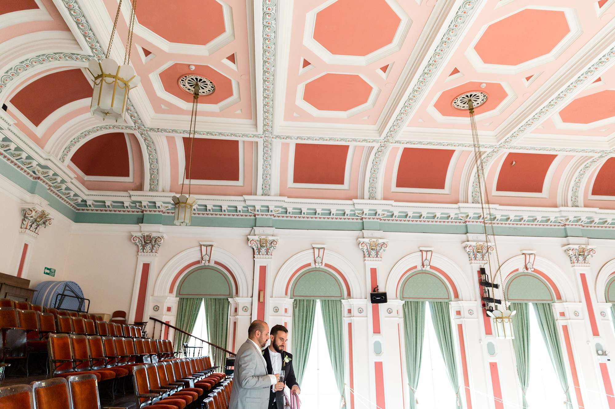 A fun Yorkshire Wedding grooms pose in front of beautiful victorian ceiling