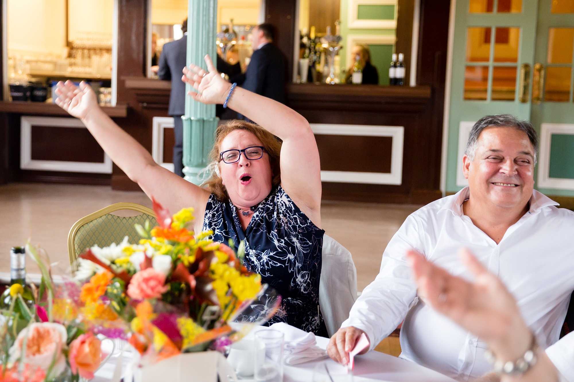 A fun Yorkshire Wedding guests waving arms to music