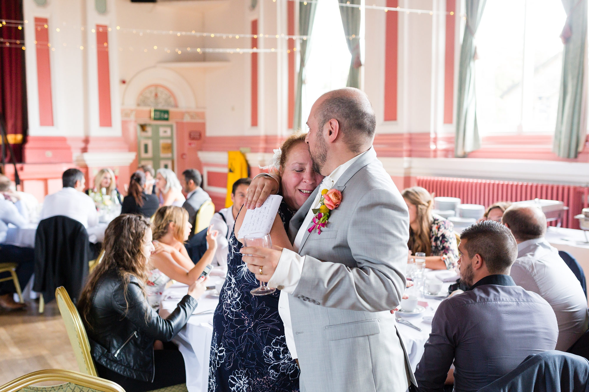 Emotional hug from groom to firend at Victoria Hall wedding