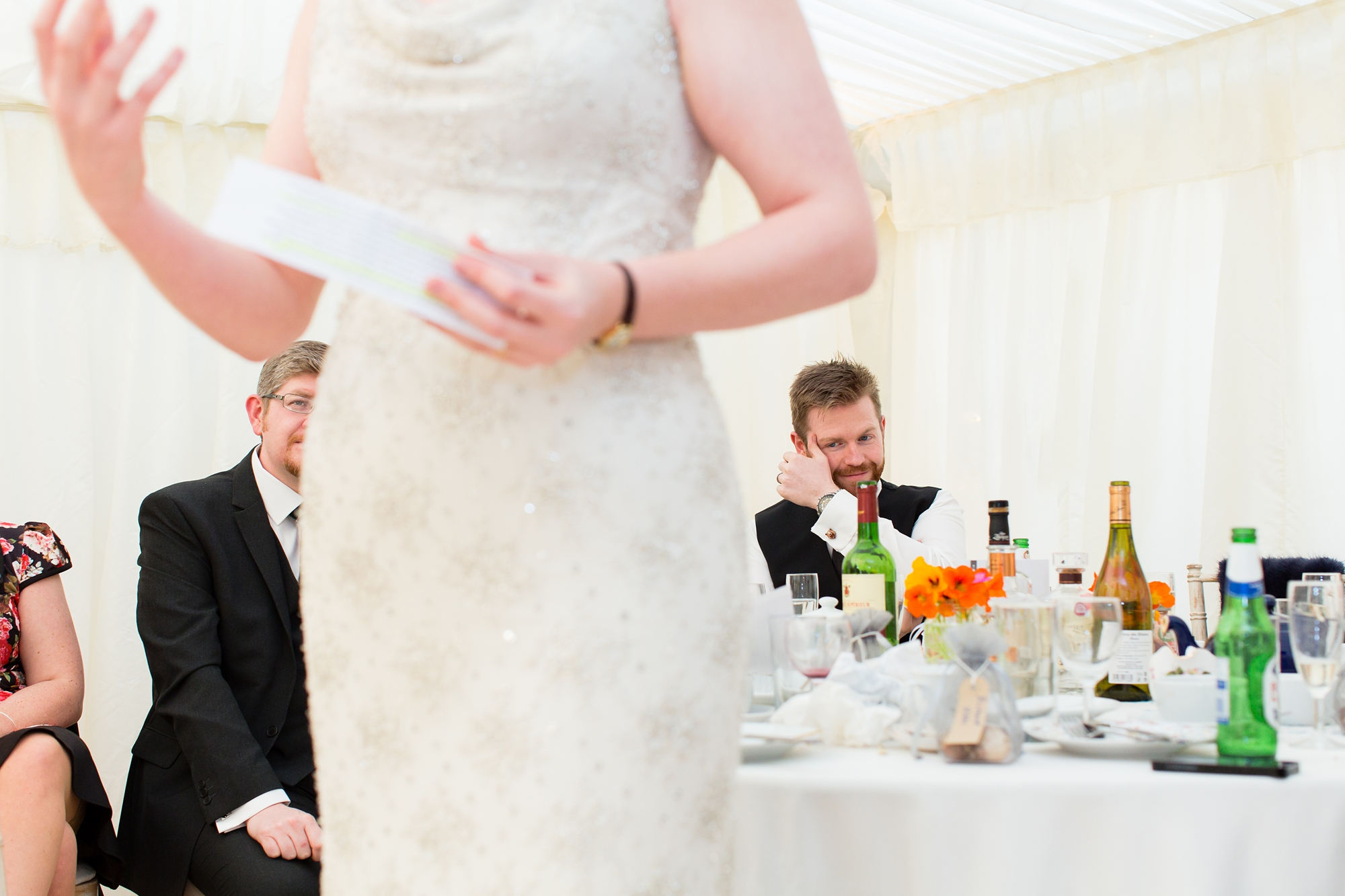 Groom cries whilst standing behind beide giving speech