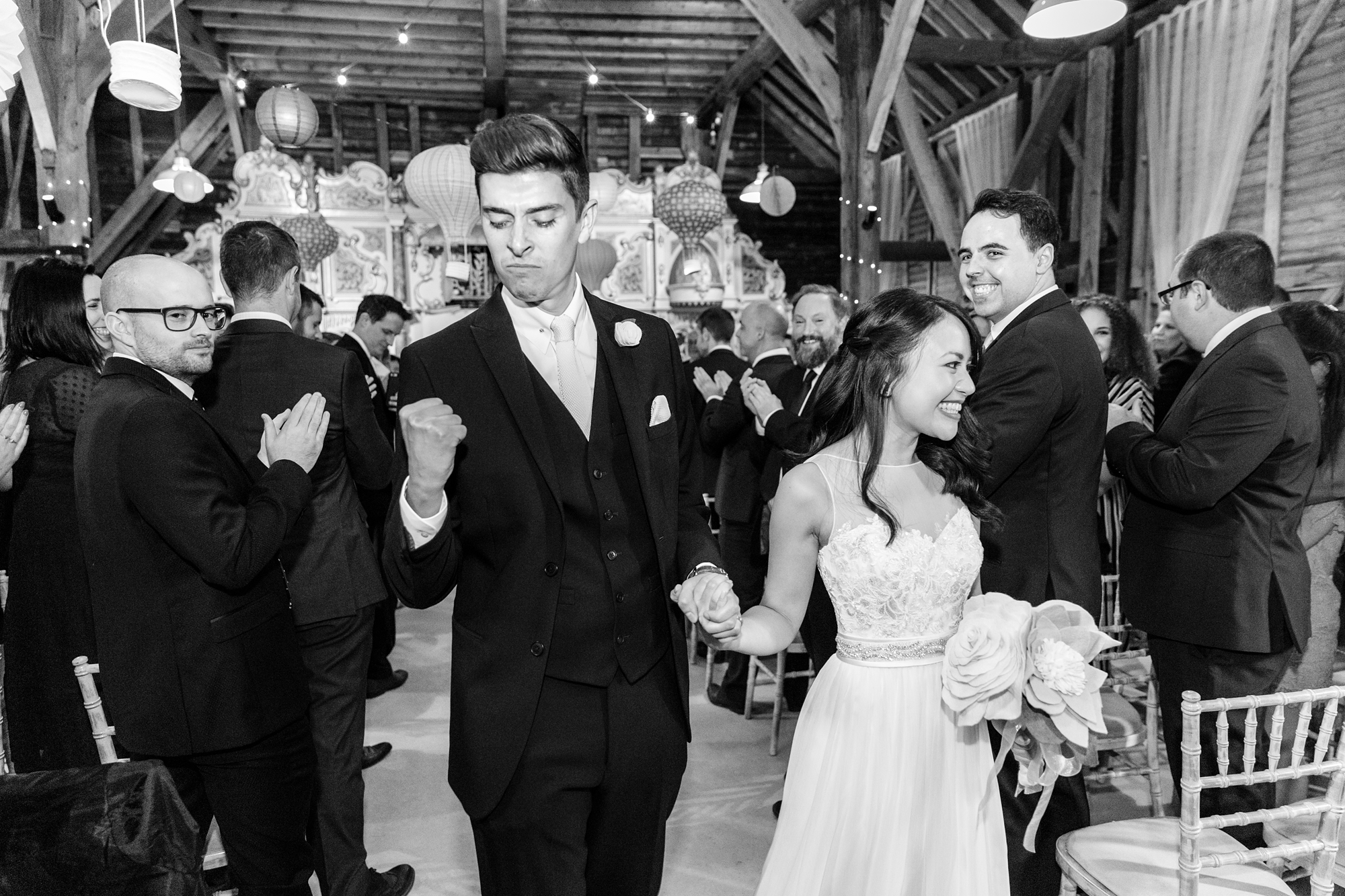 Groom fist pump as he walks back up aisle Preston Court Wedding Photography