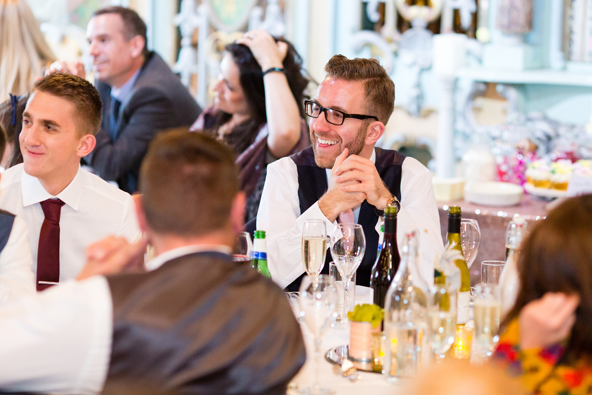 Preston Court Wedding Photography guest laughing during the speeches
