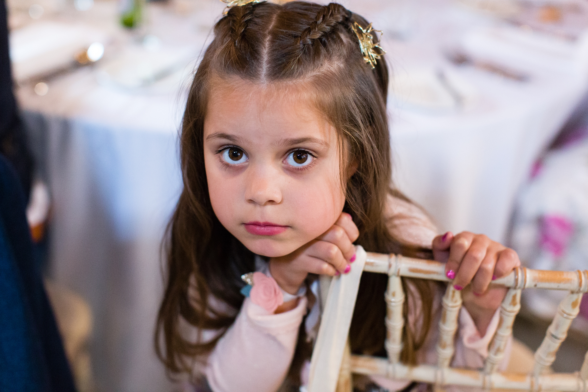 Cute flower girl looking at camera