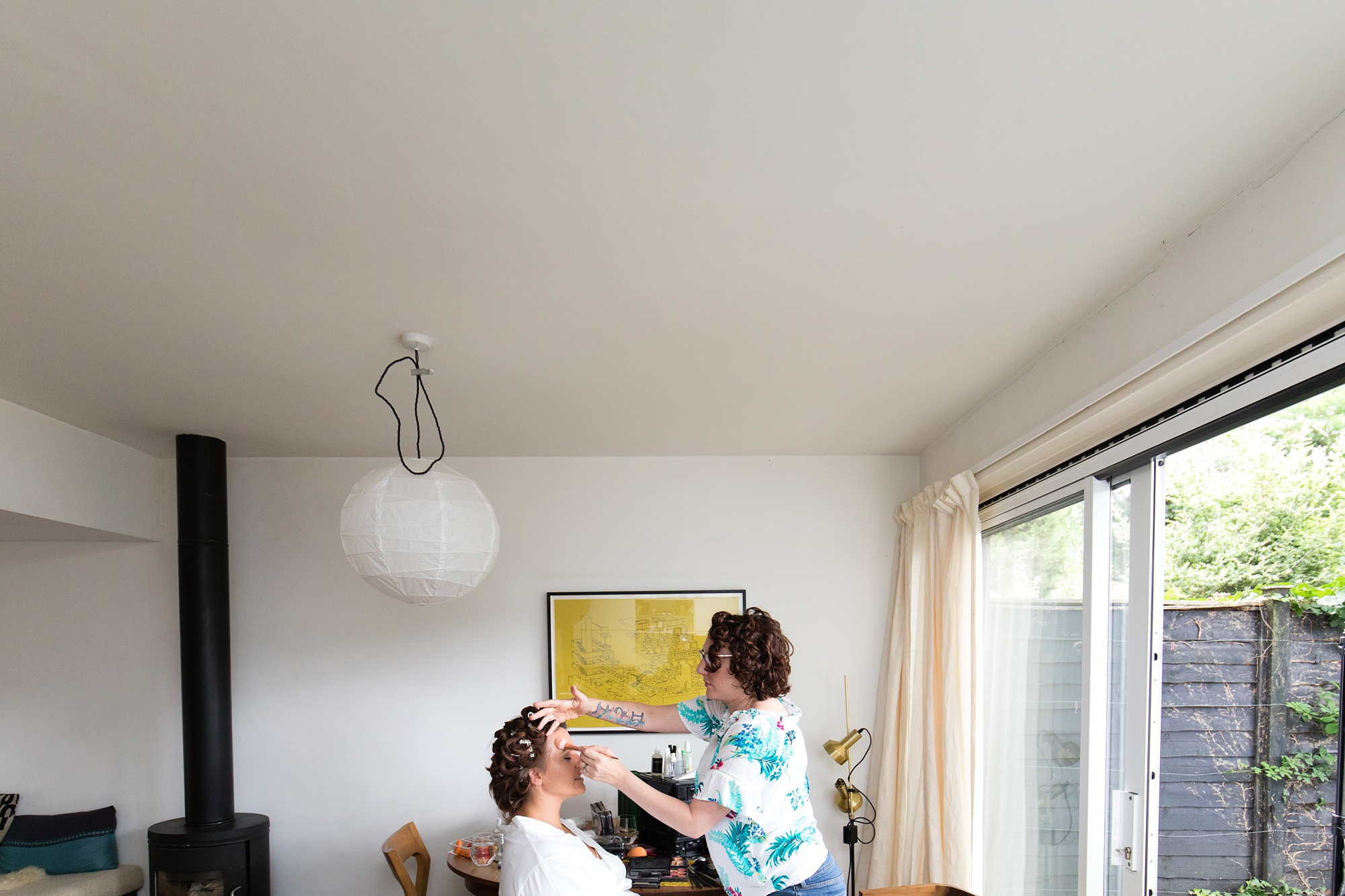 bridal preparation photograph with negative space near ceiling London wedding