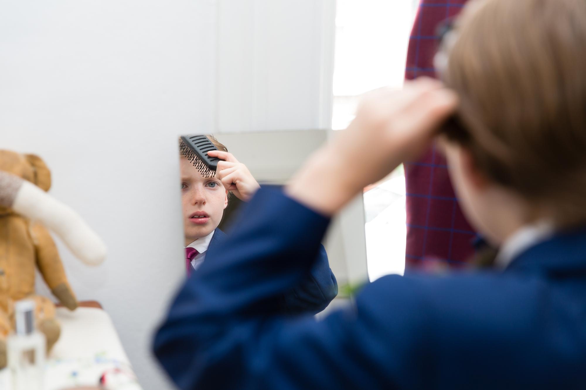 Groom's son brushing his hair