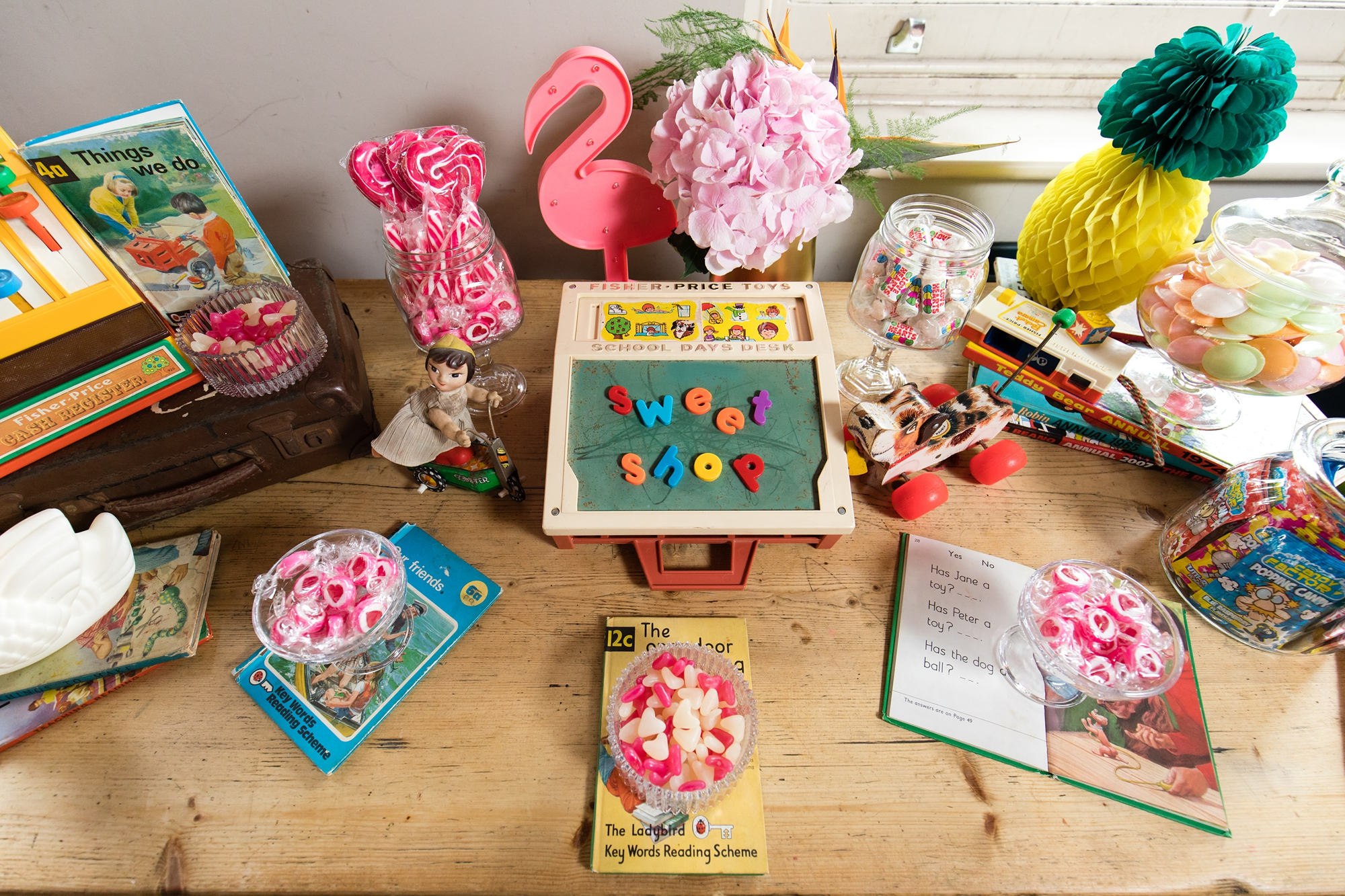 Quirky and fun wedding details with flamingos and children's toys