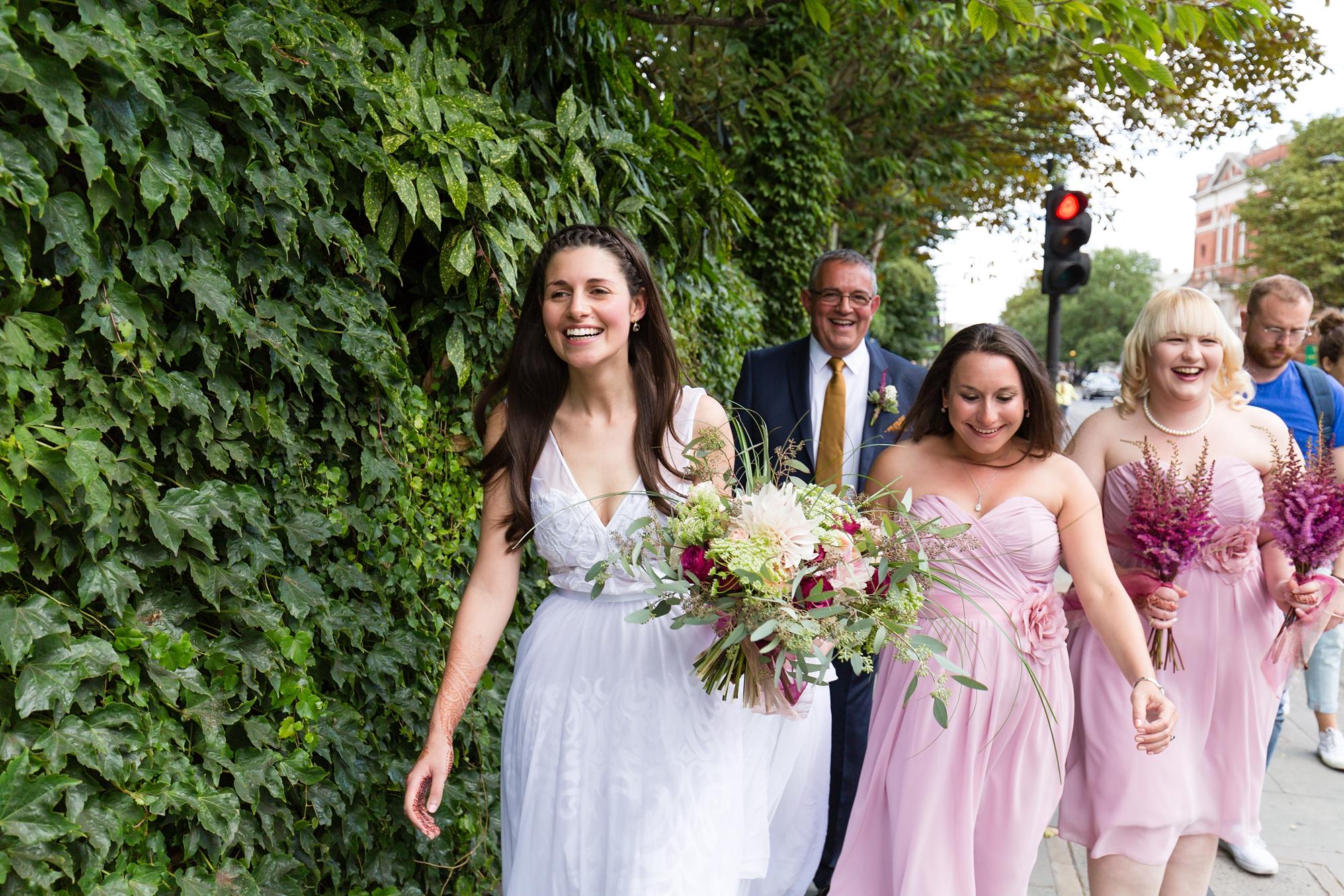 Bride walks to venue St. Stephens Hampstead Wedding