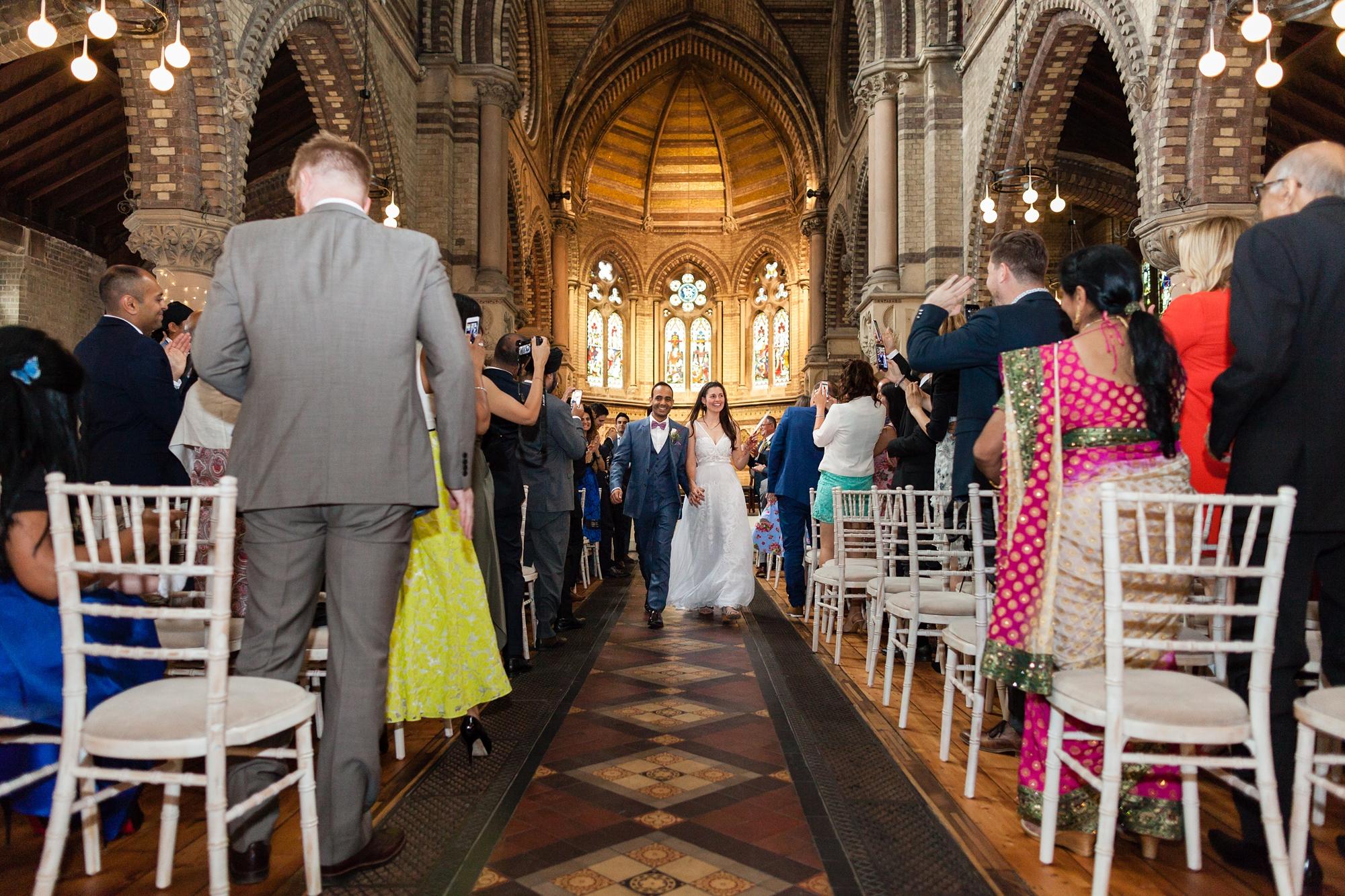 St. Stephens Hampstead Wedding couple walk up ailse