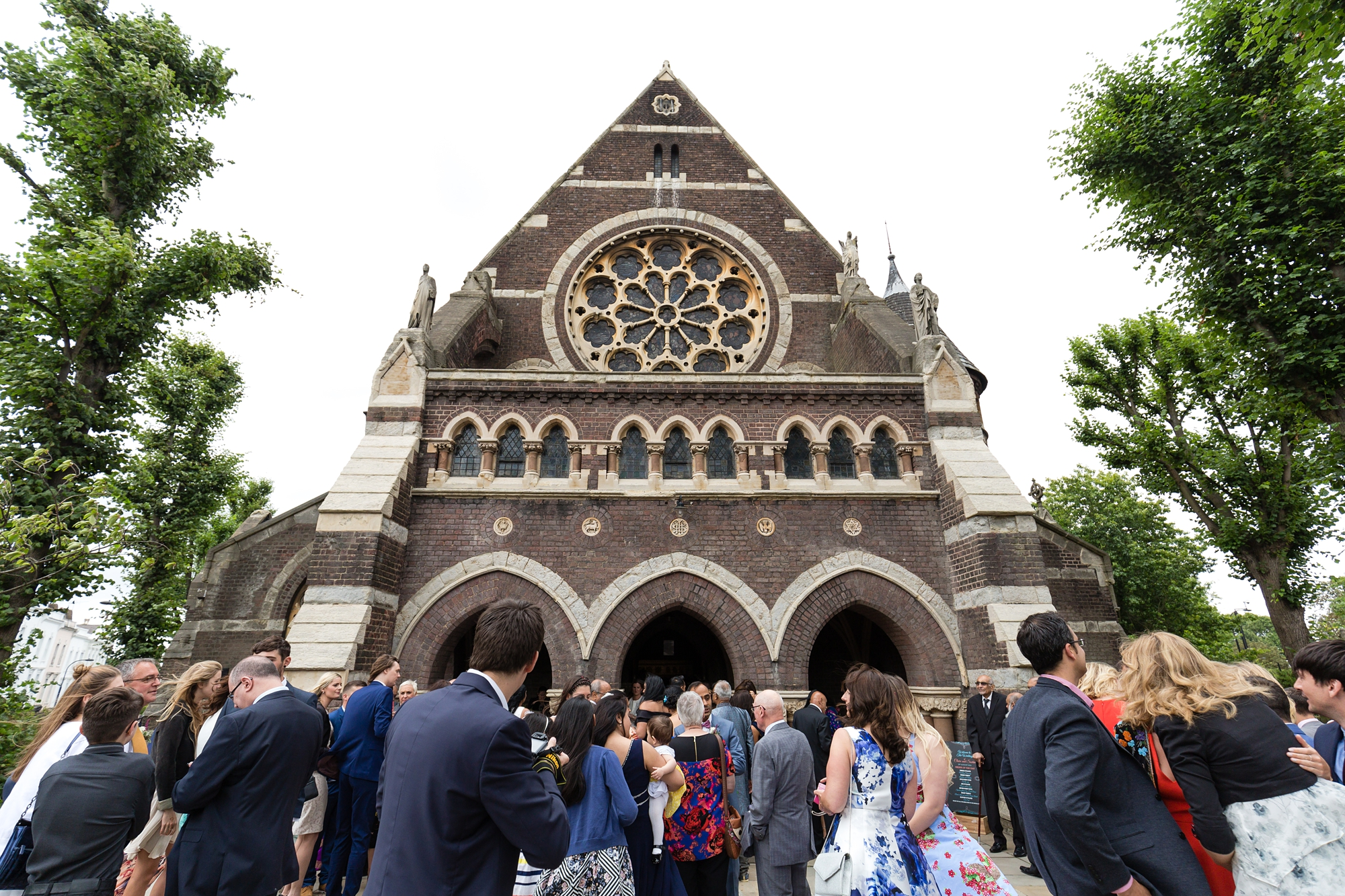 St. Stephens Hampstead Wedding exterior of building with guests mingling