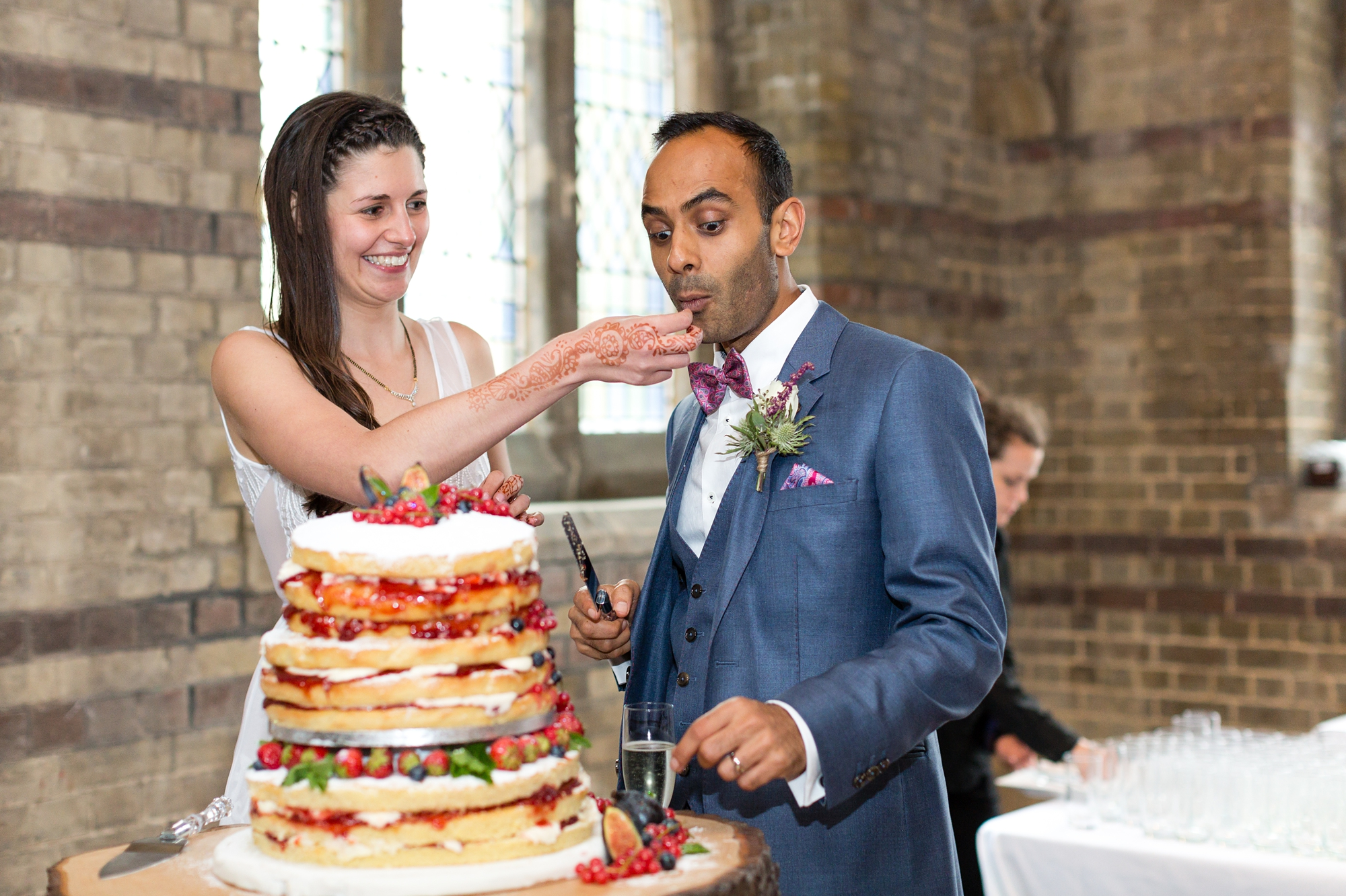 St Stephens Hampstead Wedding Photography funny cake cutting photo