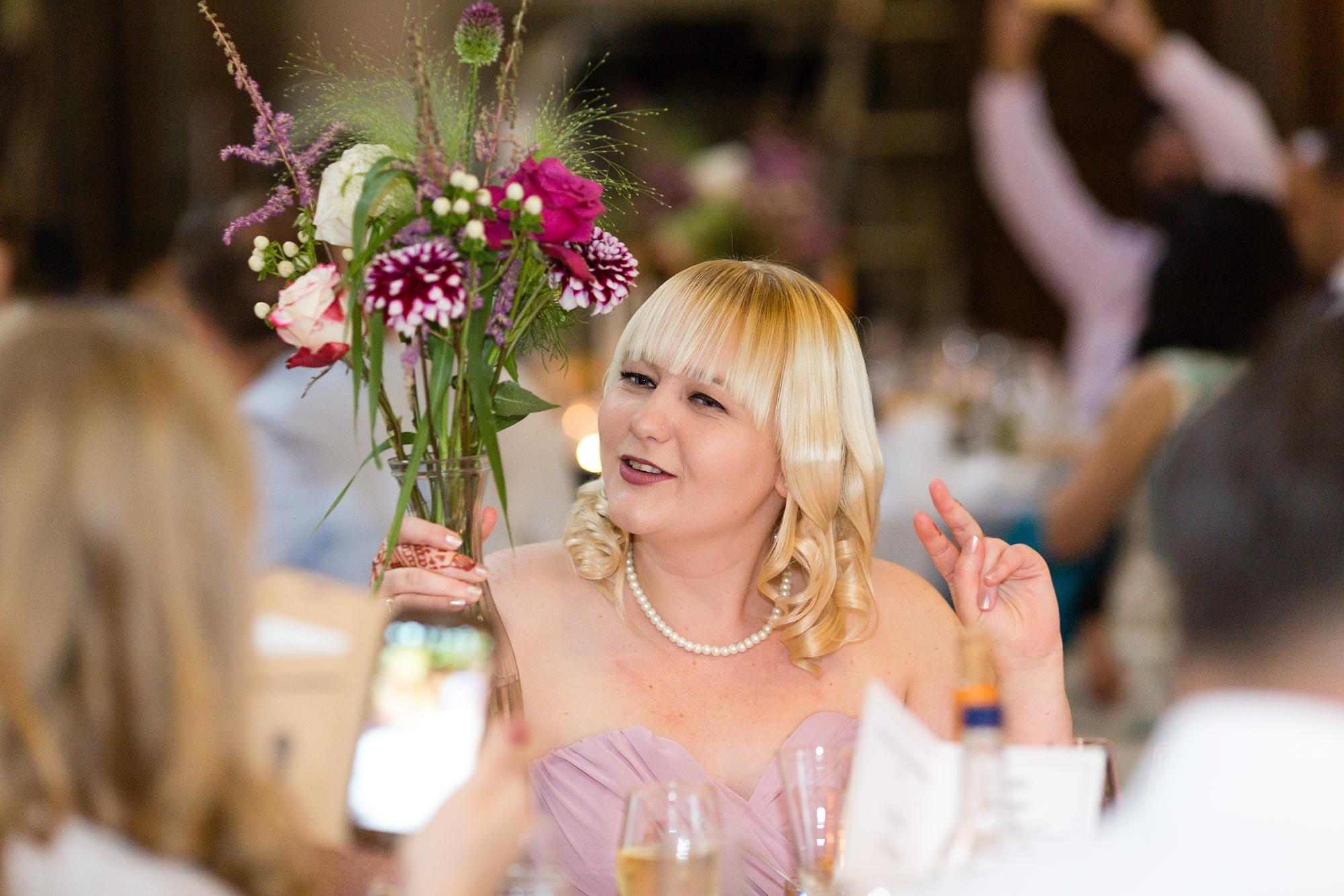 Bridesmaid makes peace symbol