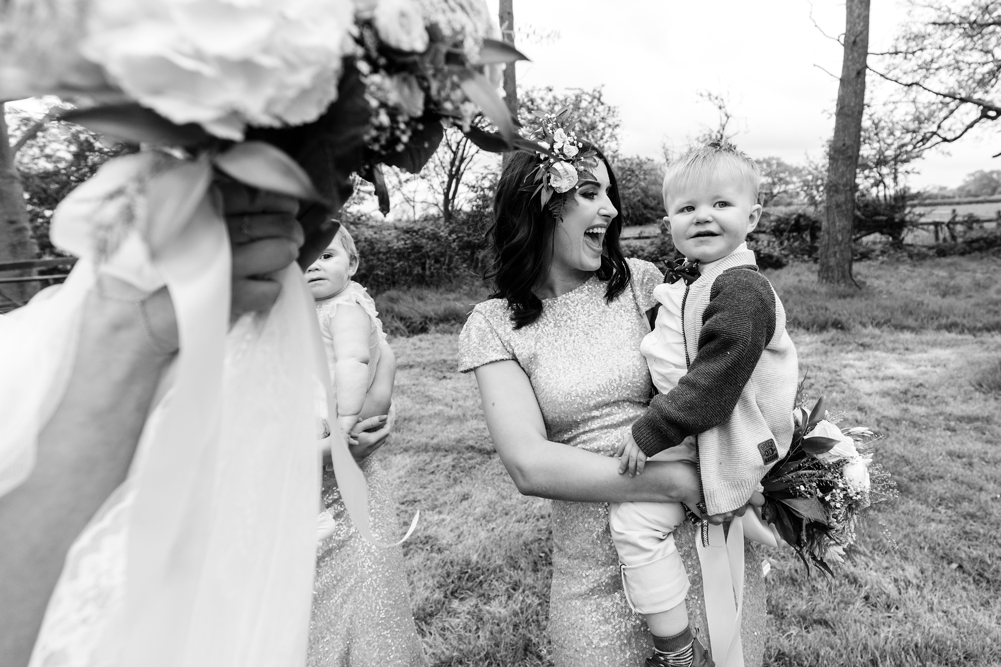 Fun, candid photo of bridesmaid holding baby