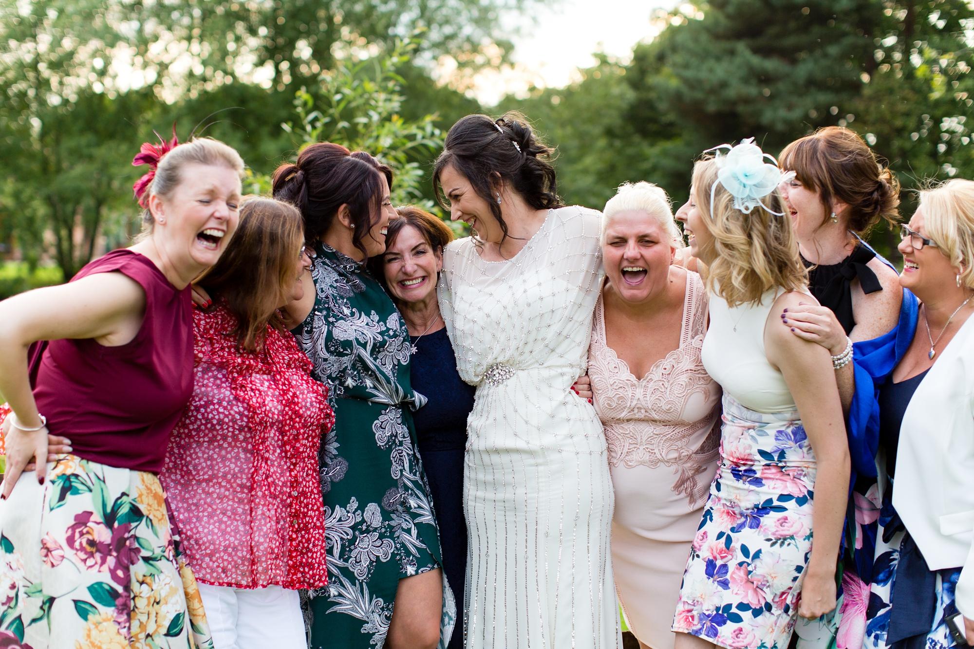Villa Farm Weddings bride laughing with bridesmaids