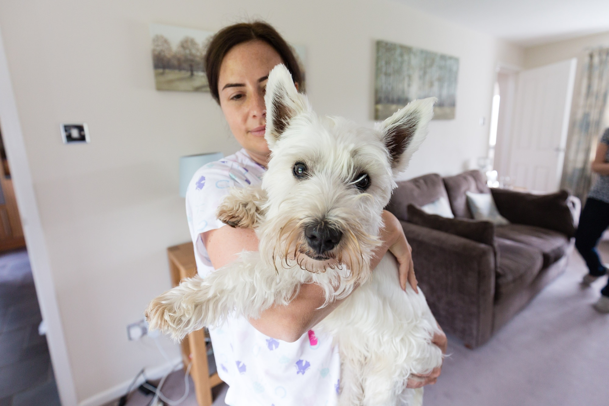 Bride shows her westie to the camera Bell Hall Wedding Photography