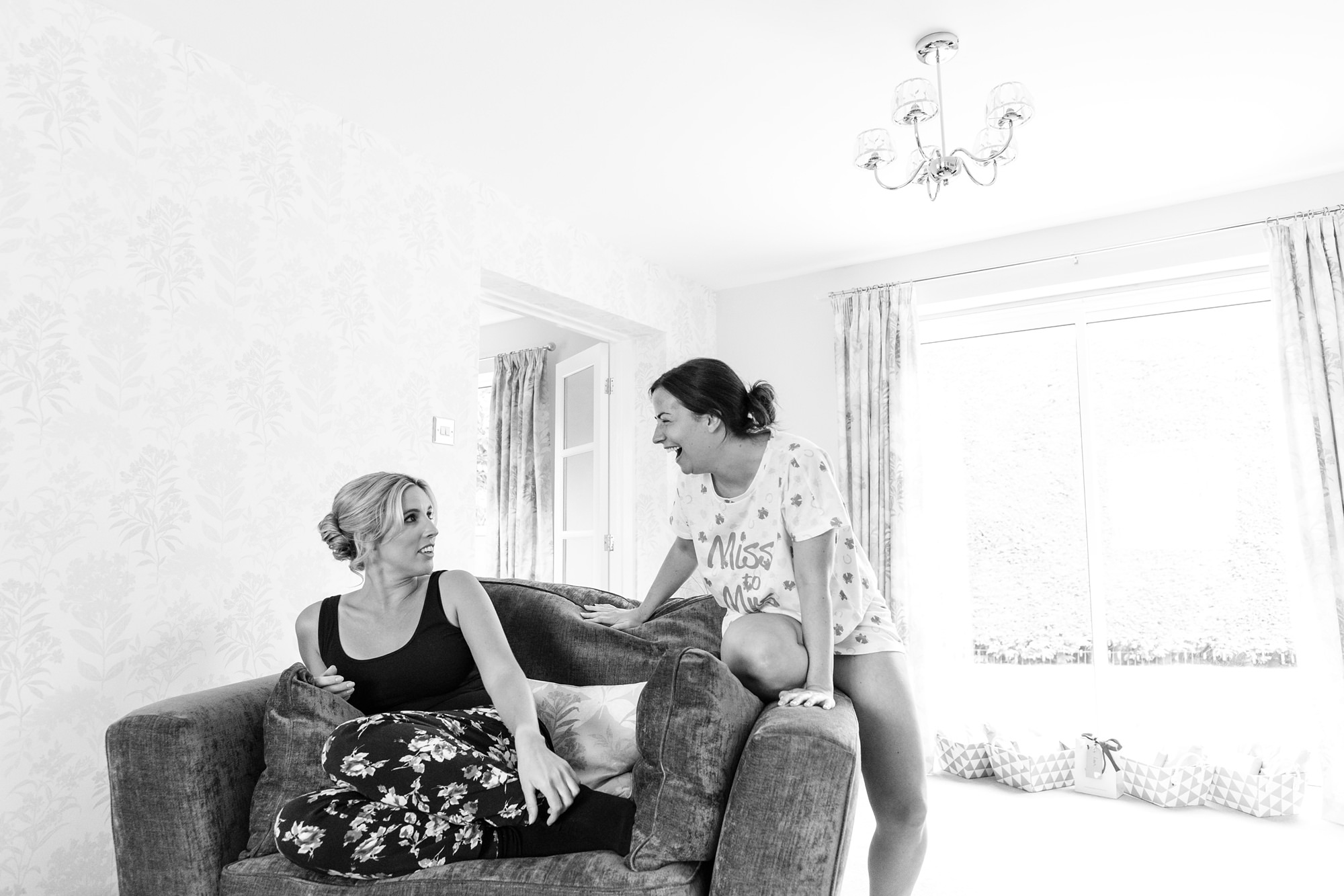 Bell Hall Wedding Photography bride and bridesmaid laughing i=during bride prep