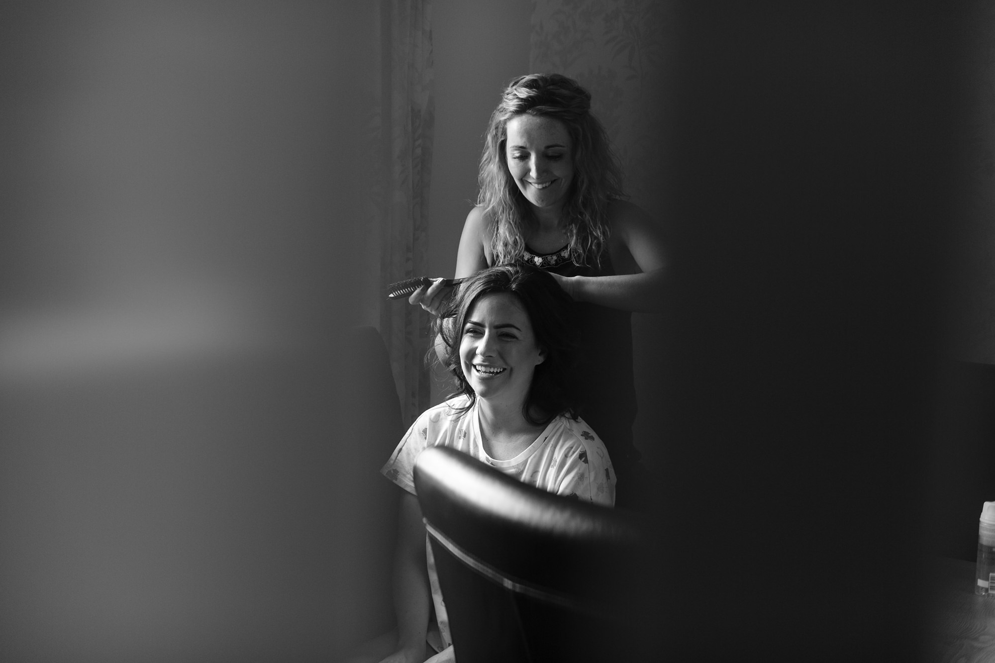 Documentary photograph of bride during preparation