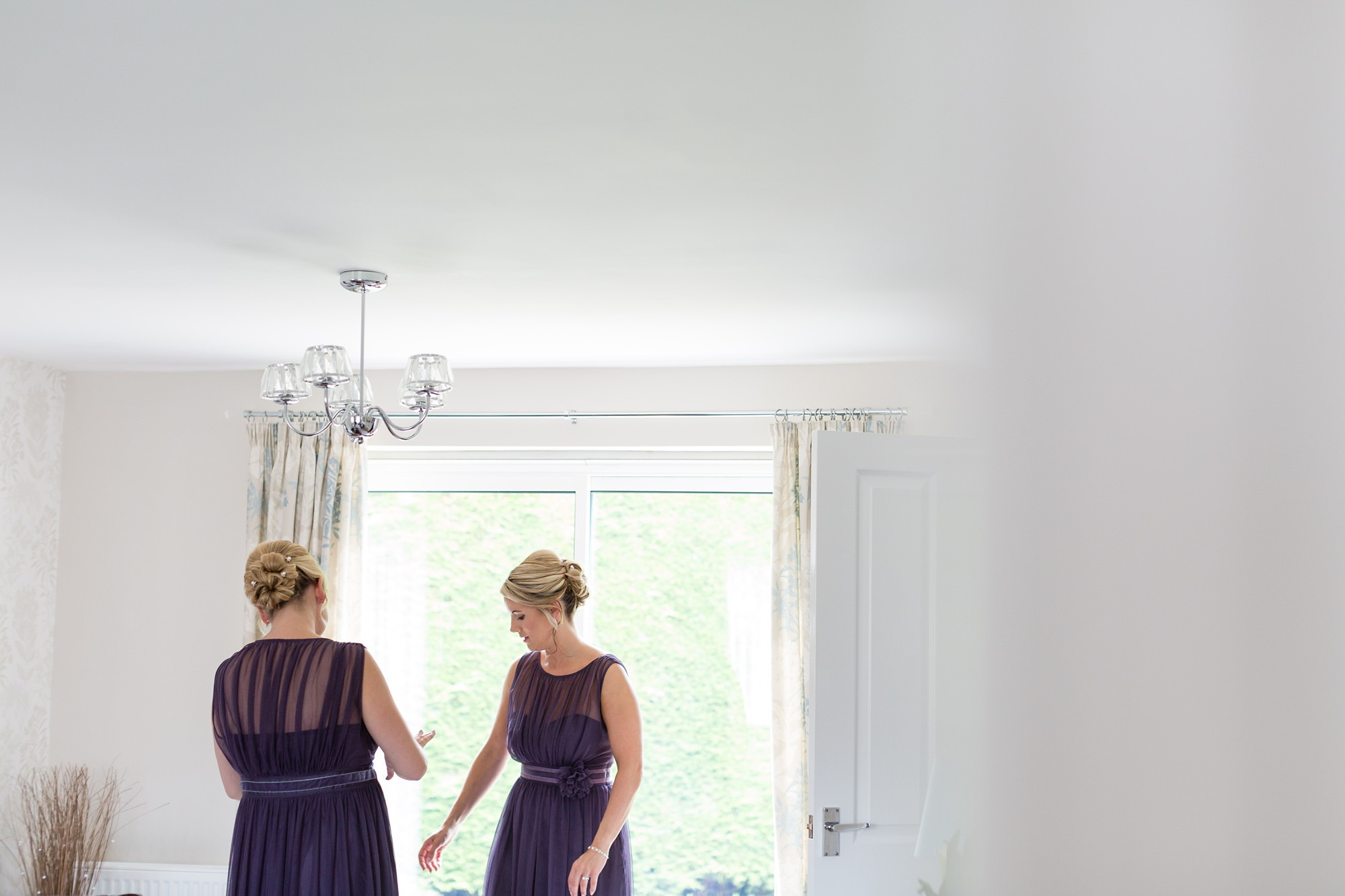Bridesmaids framed by window Bell Hall Wedding Photography