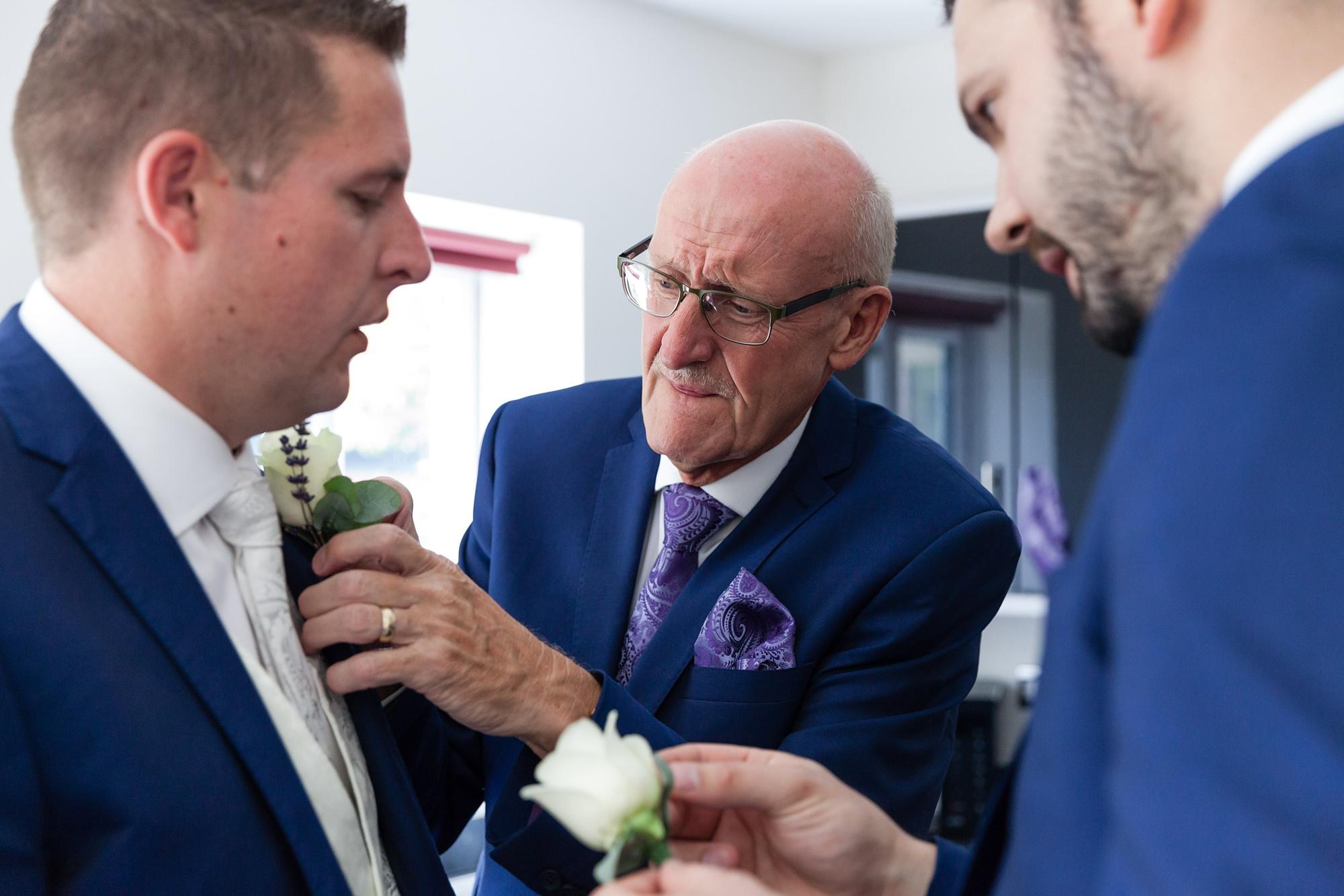Groom prep - dad tying everyone's tie
