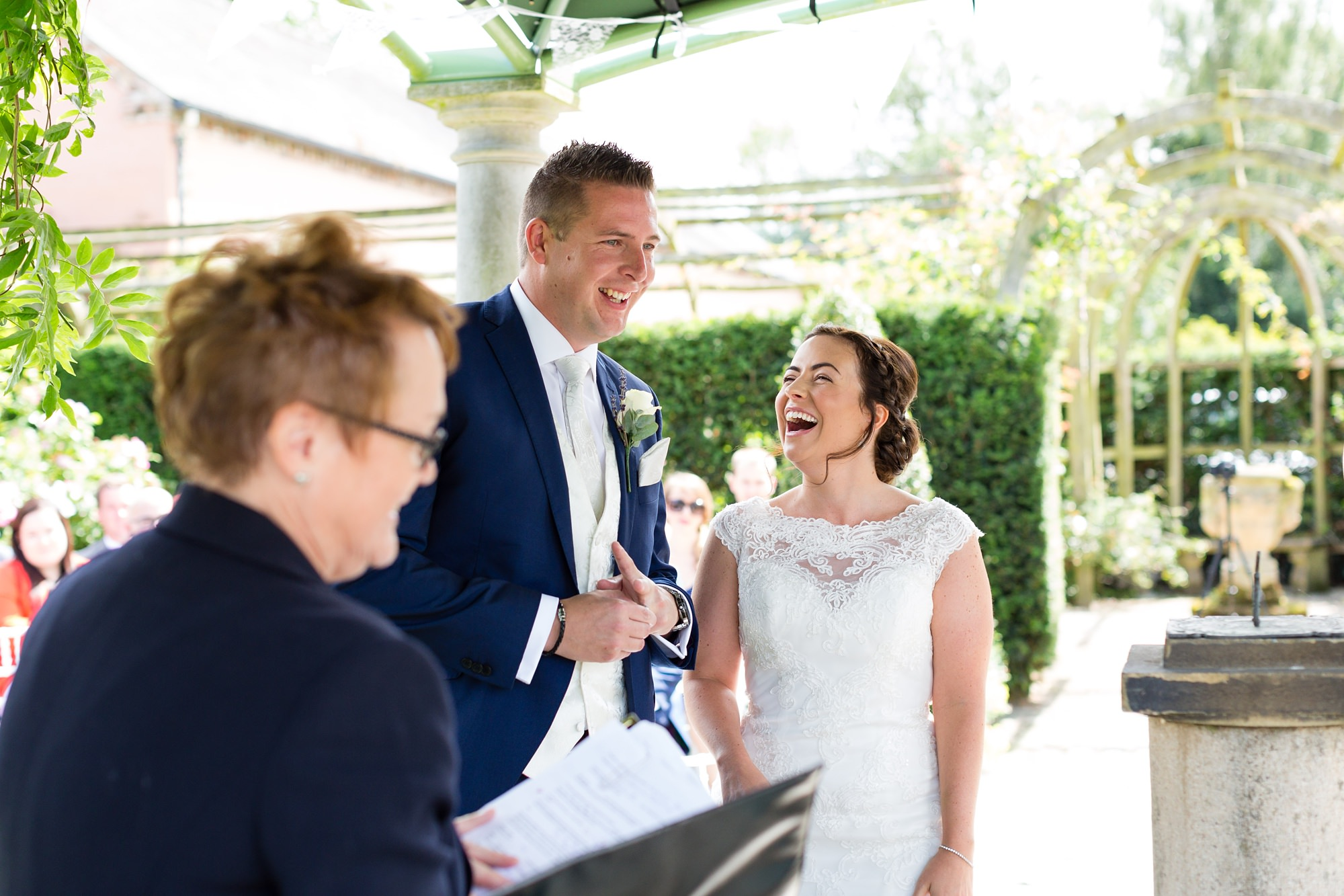 Bell Hall Wedding Photography bride laughing during outdoor wedding ceremony