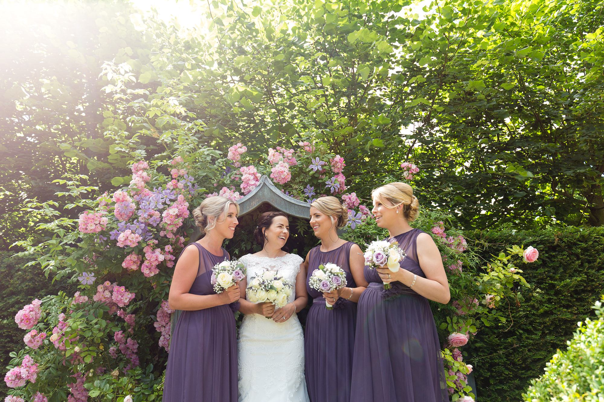 Bell Hall Wedding Photography bride and bridesmaids in purple dresses in front of hydrangeas