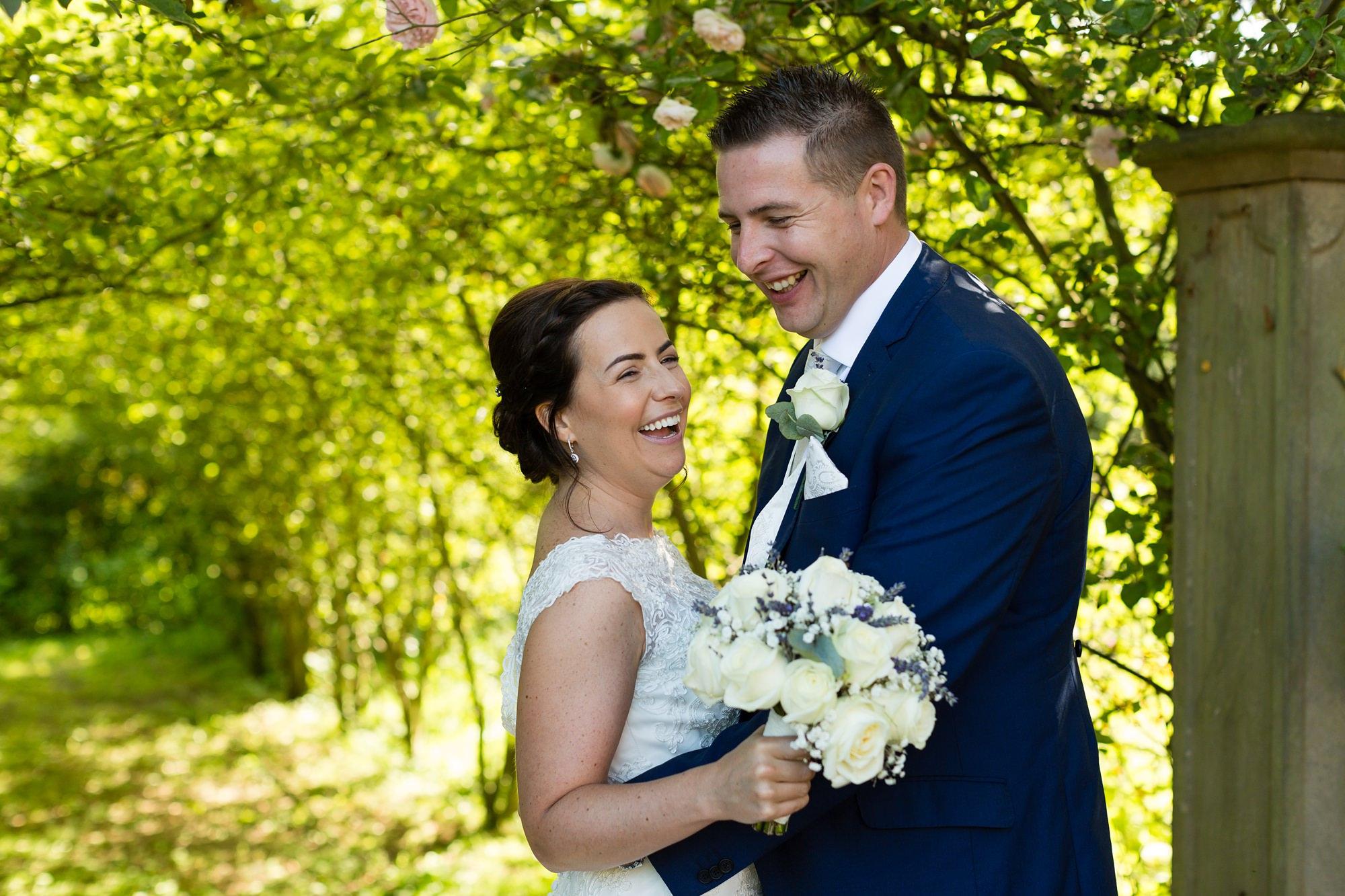 Fun wedding photography couple laughing