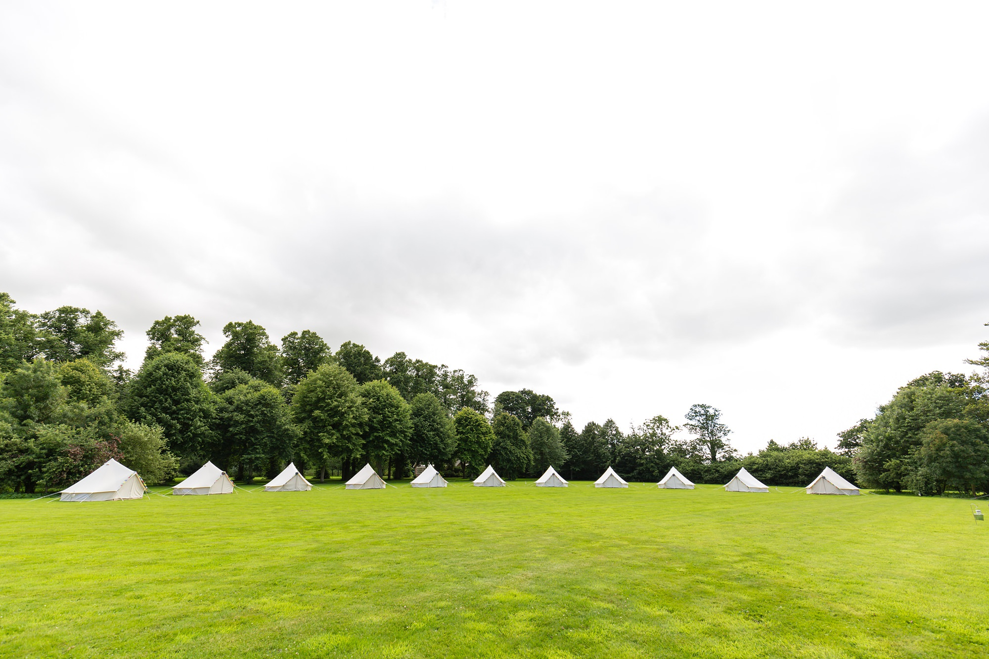 Bell Hall Wedding Photography bell tents in the field