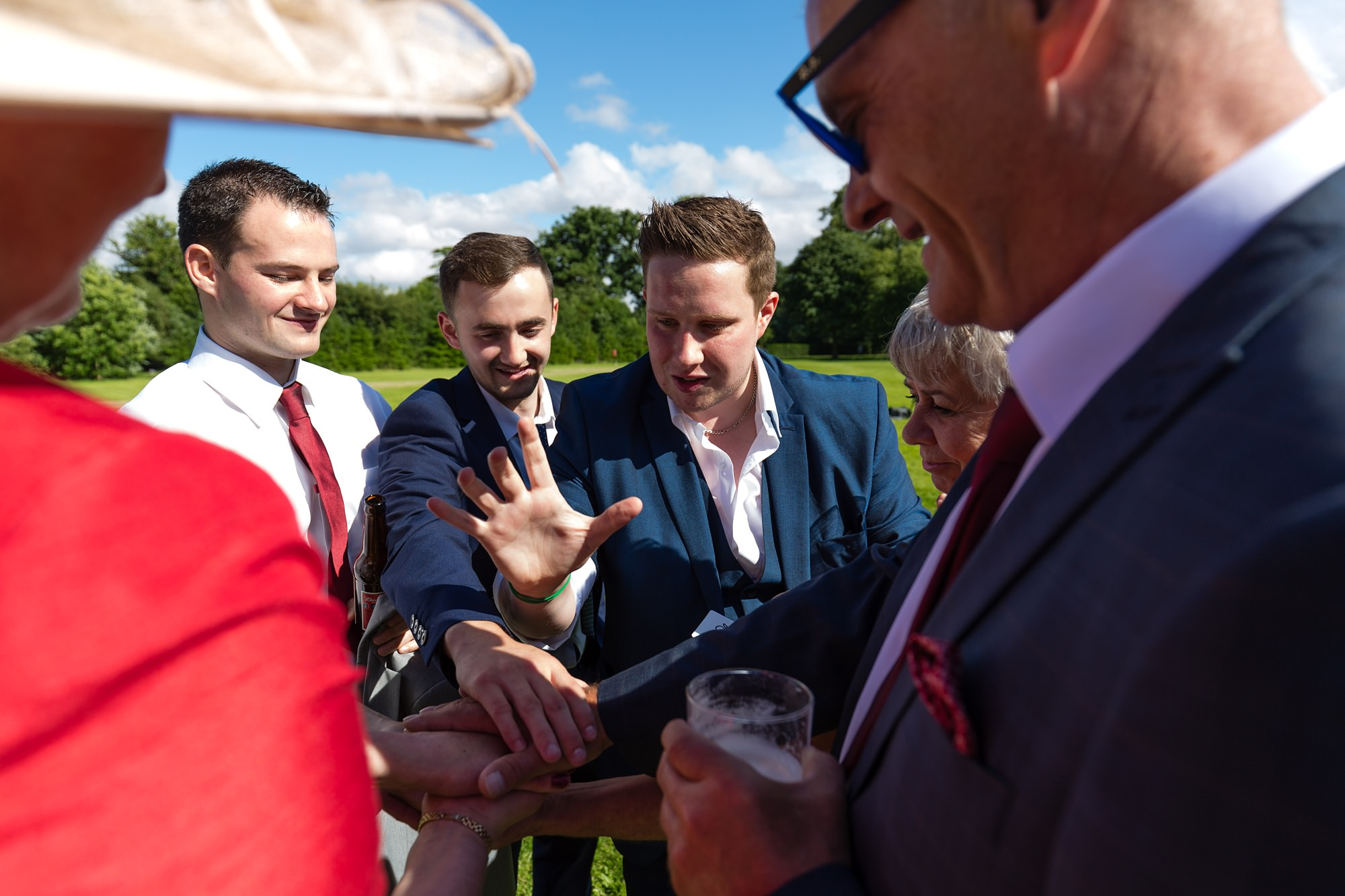 Bell Hall Wedding Photography magician performing a trick for guests