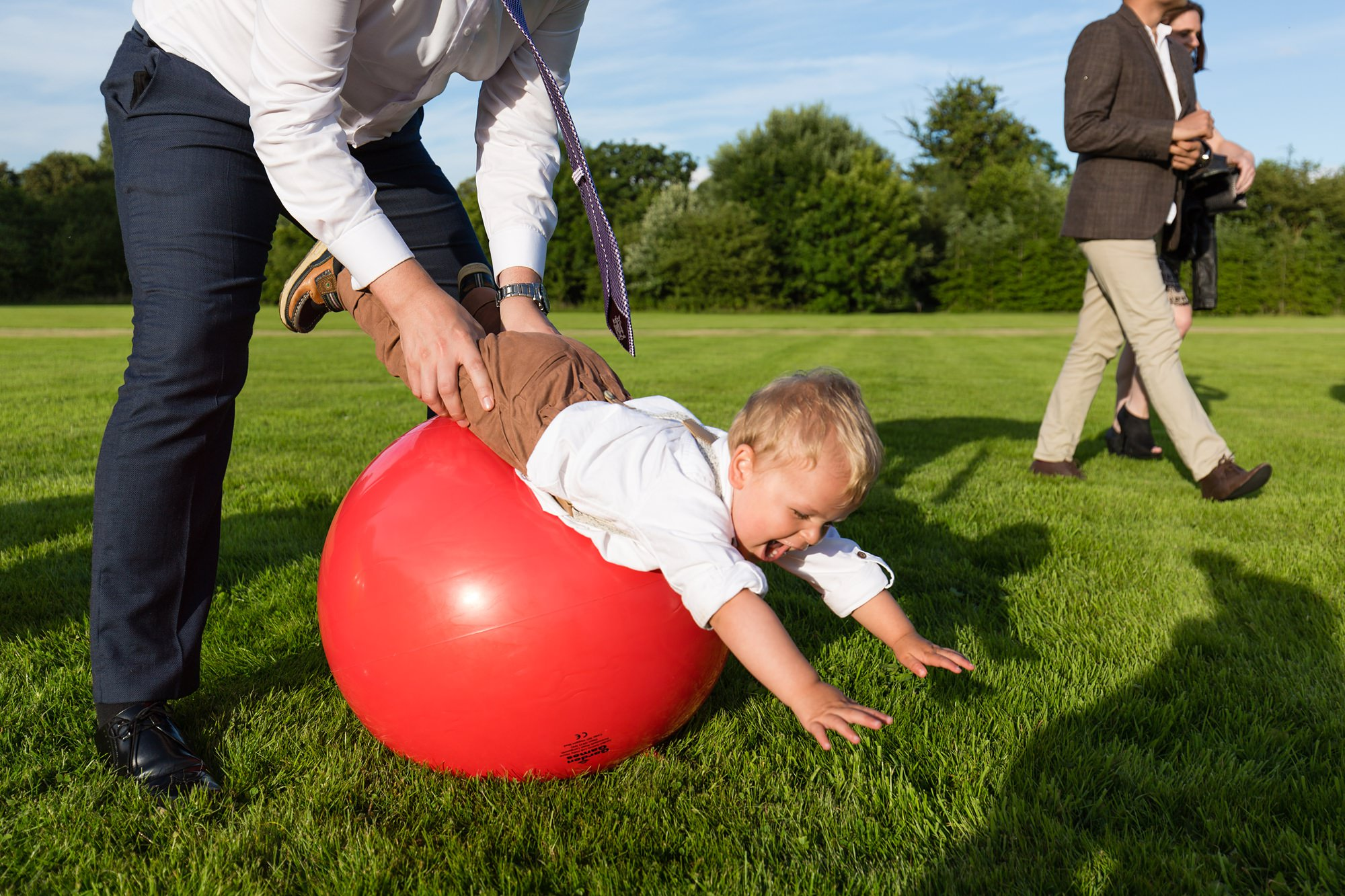 Fun wedding photography kid rolling over spacehopper