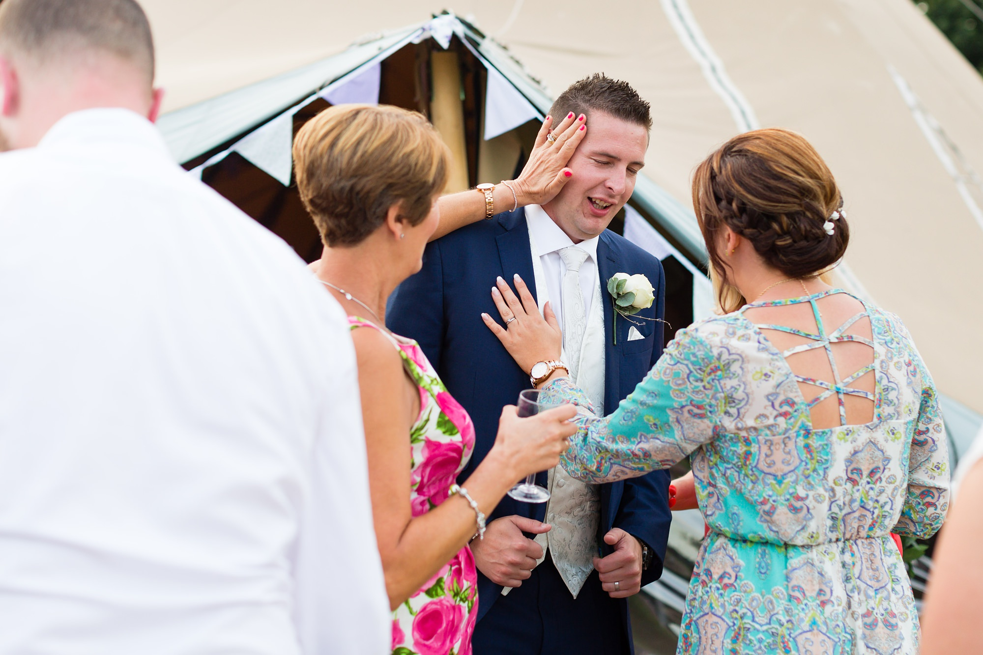 Guests having fun with groom at Yorkshire wedding