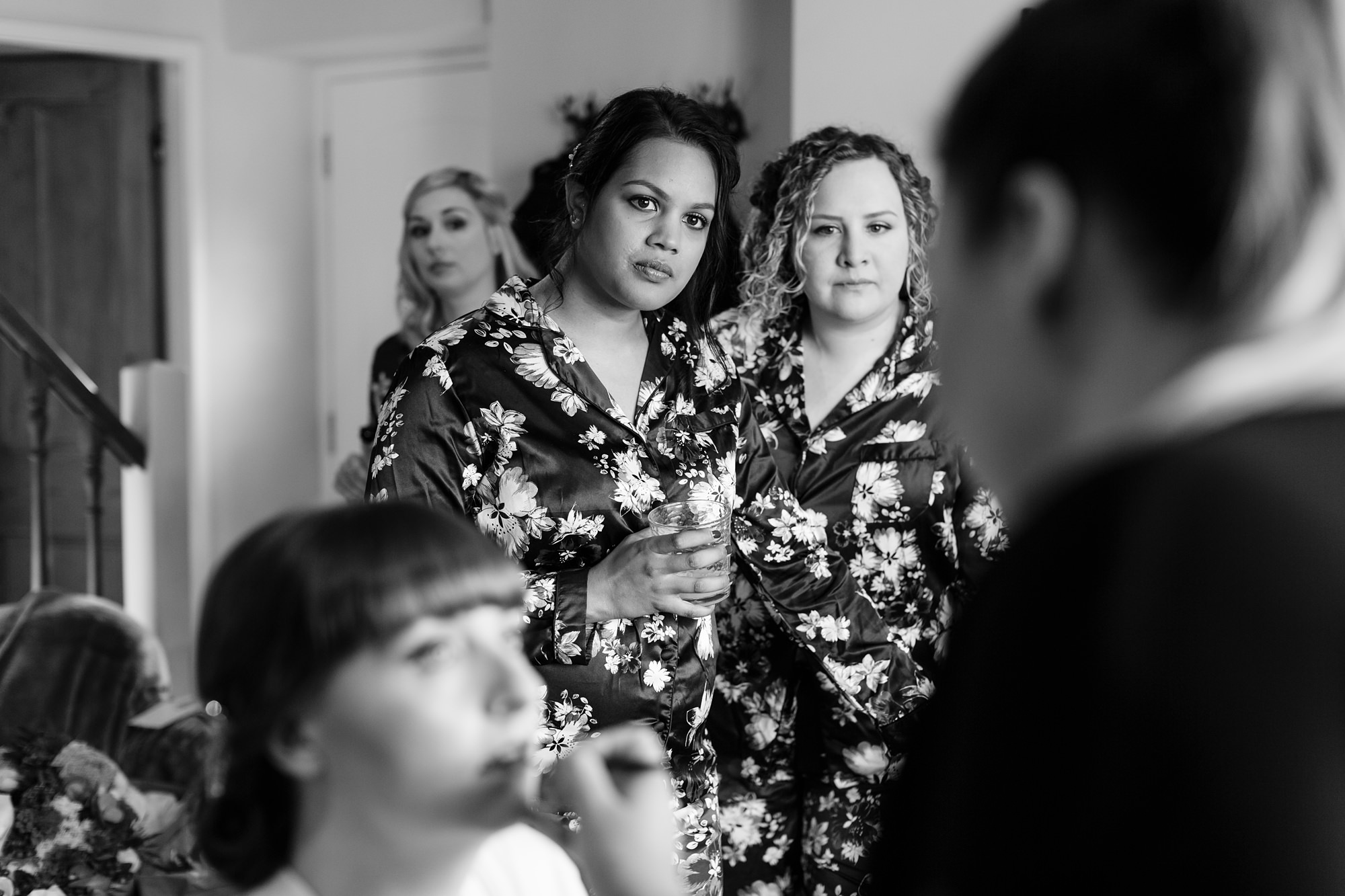 Bridesmaids watching as bride's makeup is being done Yorkshire Wedding Photography