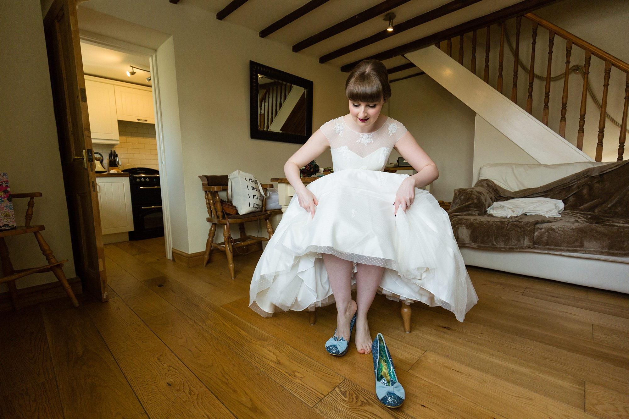 Bride putting her shoes on Yorkshire Wedding Photographer