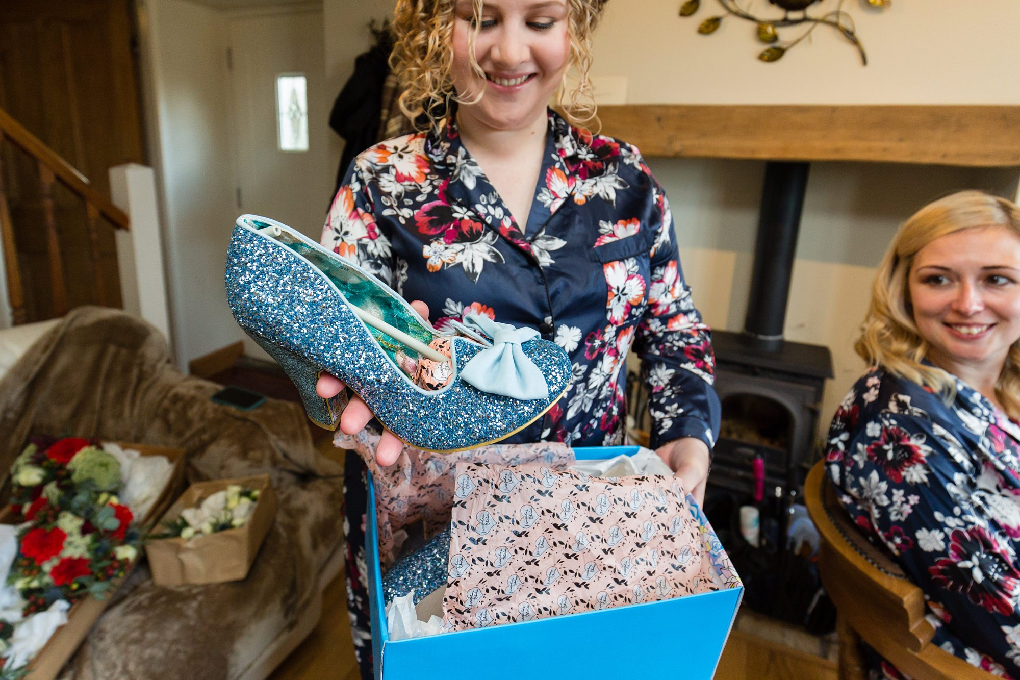 Yorkshire Wedding Photography bridesmaid shows off blue glitter wedding shoes by irregular choice