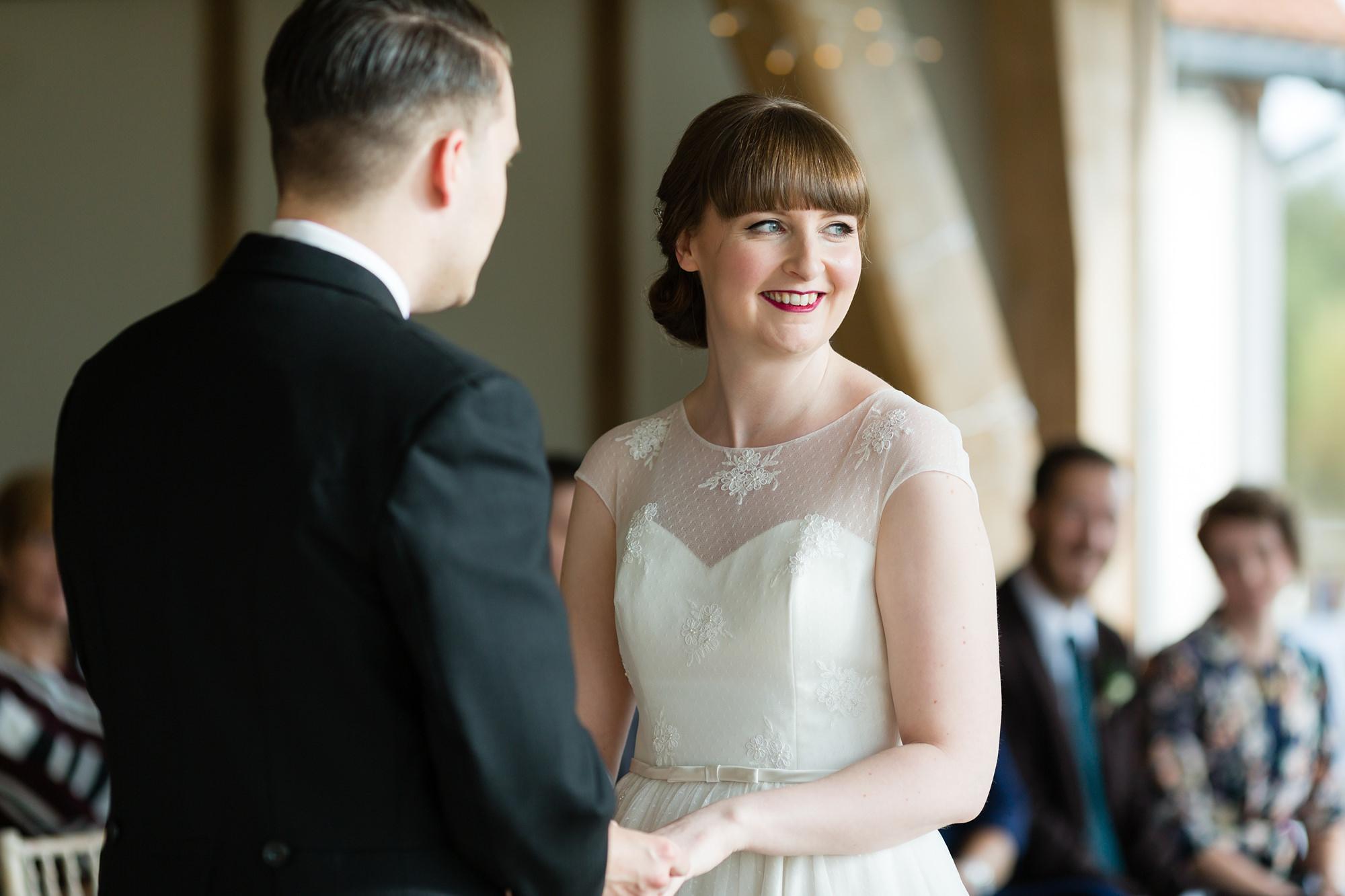 Sandburn Hall Wedding Photography bride smiles during ceremony