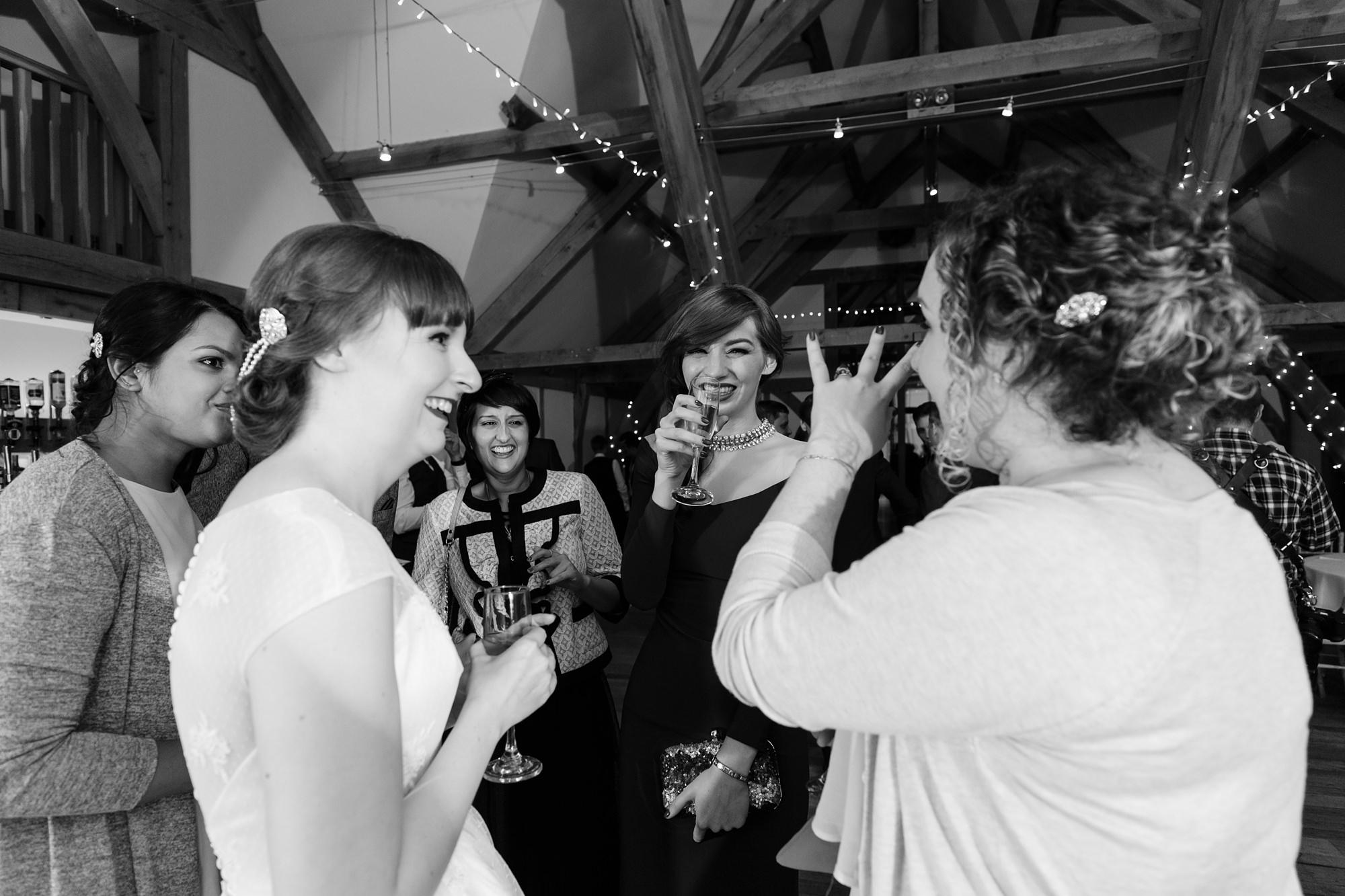 Guest at wedding party at Sandburn Hall having fun