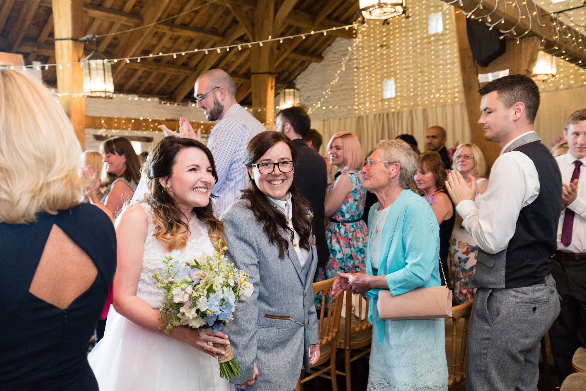 East Riddlesden Hall Wedding Photography brides walking up the aisle together