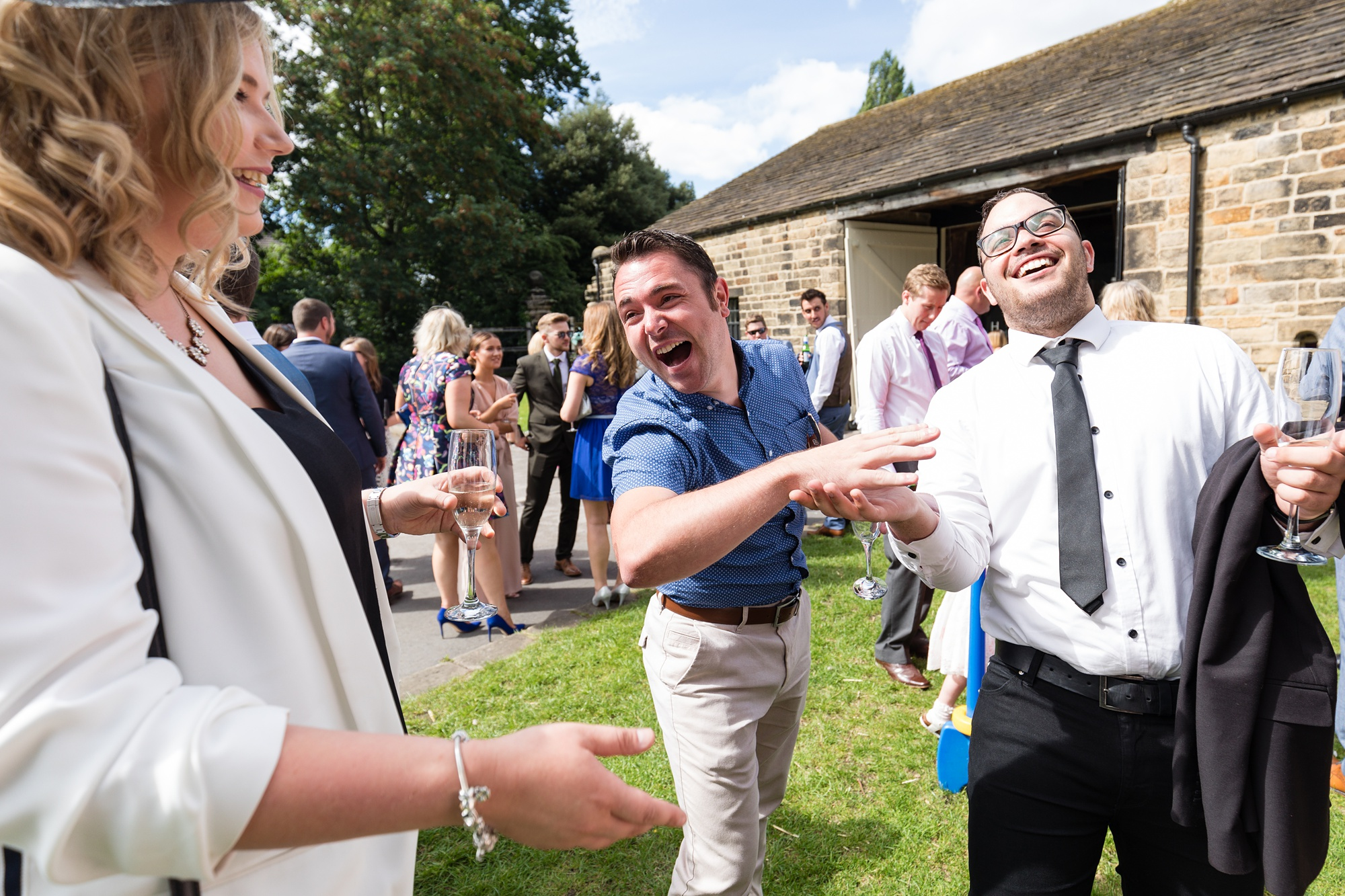 Guests laughing at East Riddlesden Hall wedding