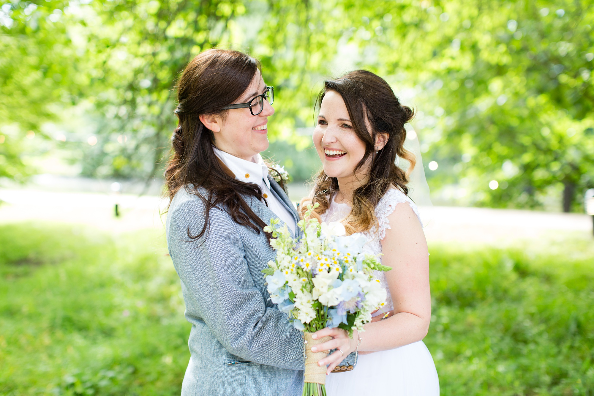 Brides cuddling at East Riddlesden Hall Wedding Photography