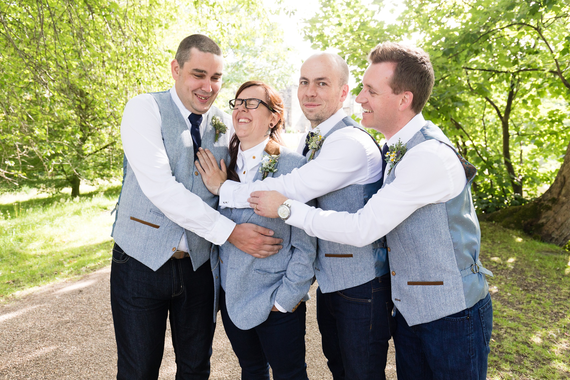 Bride laughing with bridesmen East Riddlesden Hall Wedding Photography