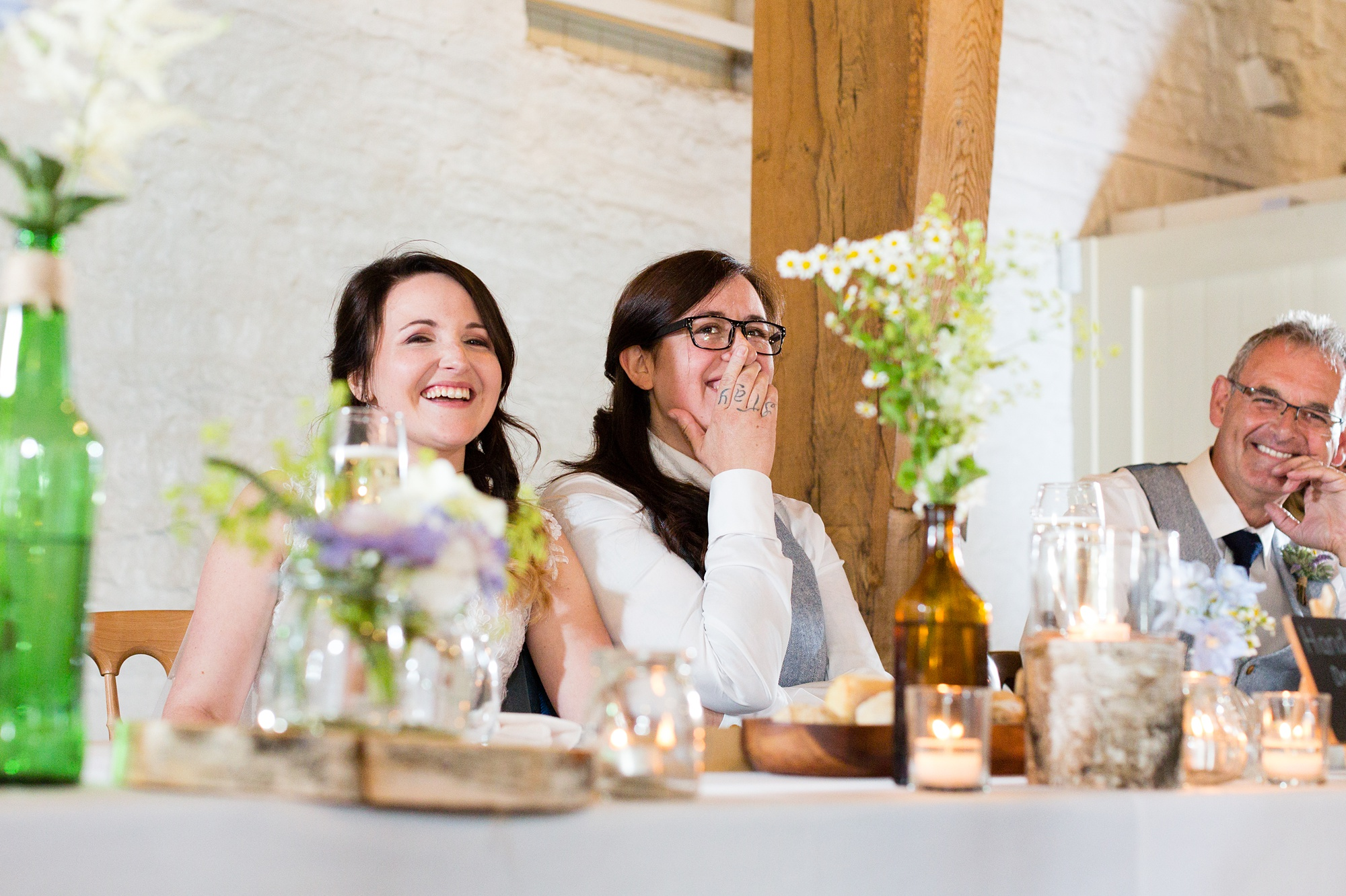 Brides laughing at speeches