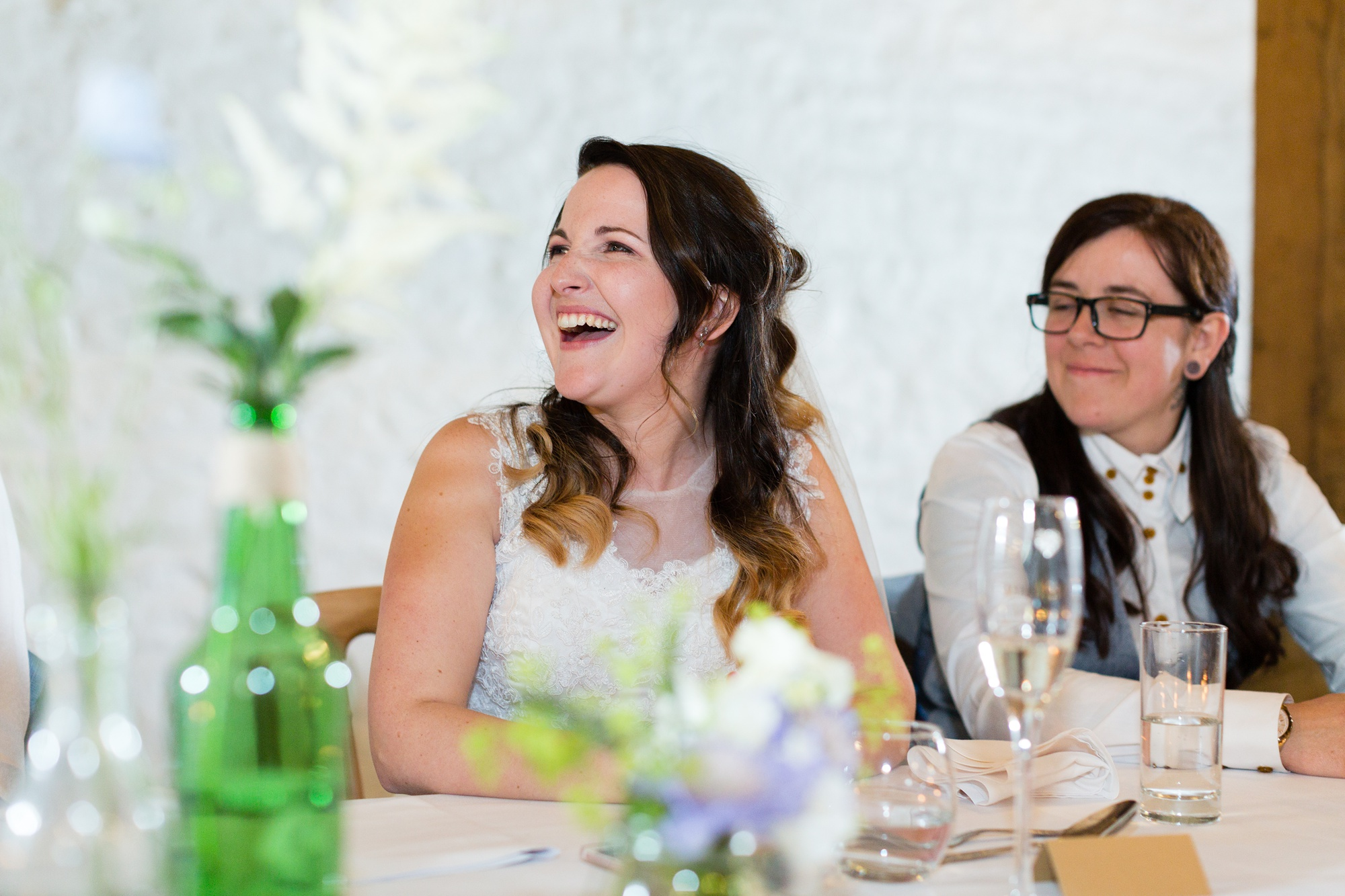 Brides laughing during speeches