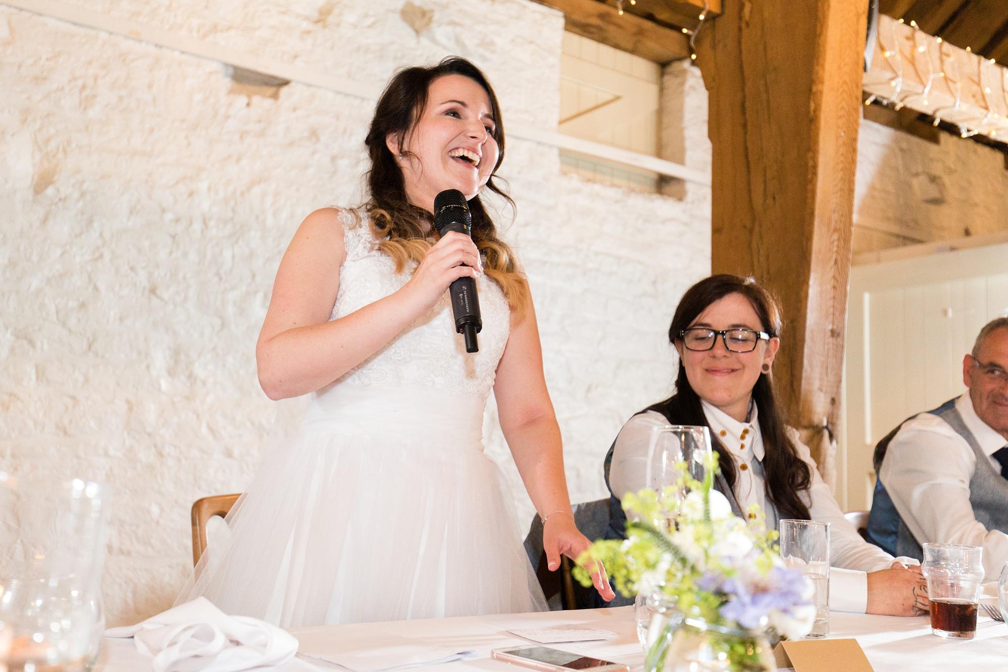 Bride giving speech at her wedding at East Riddesden Hall