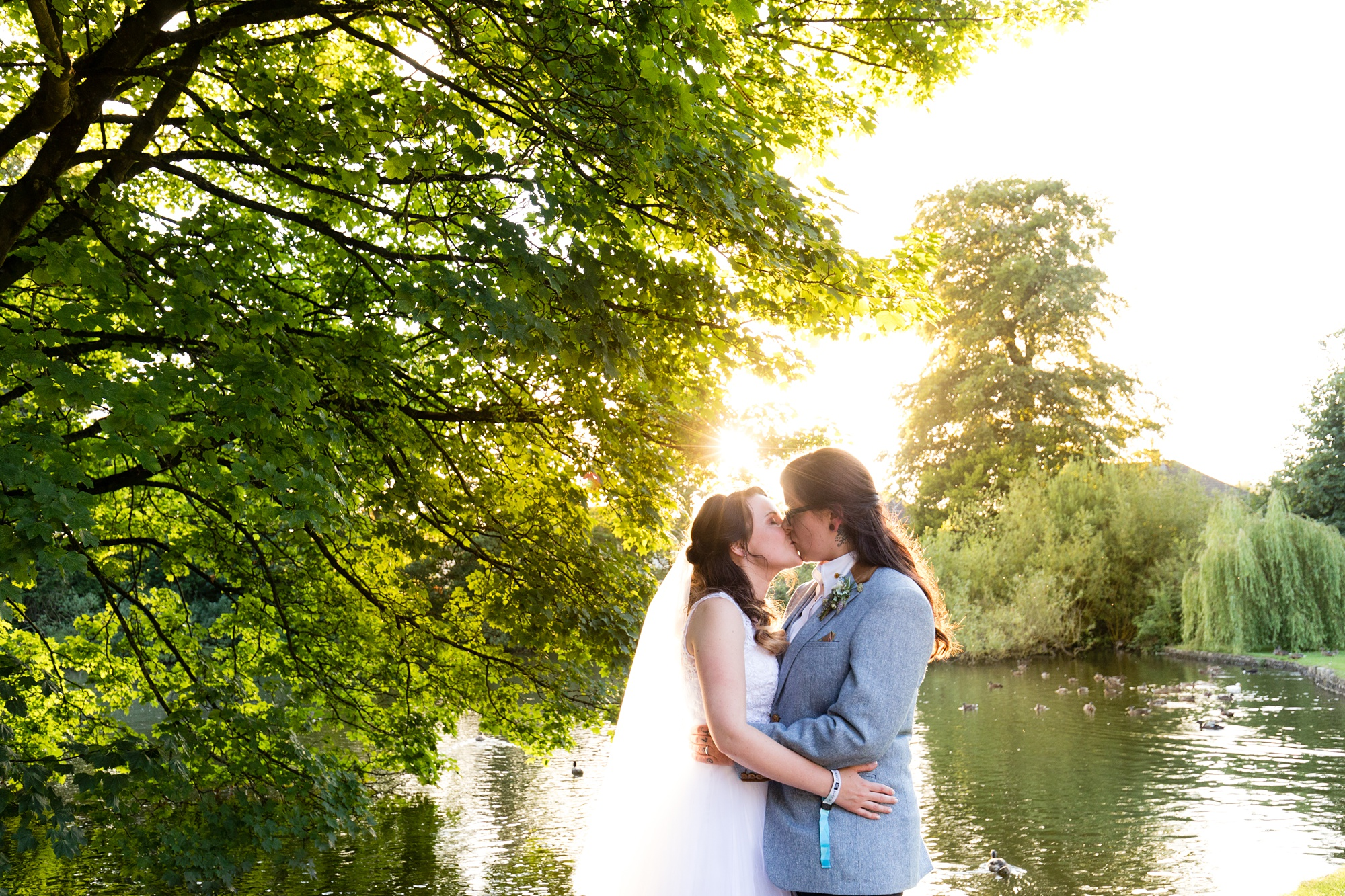 Brides kissing in the sunset East Riddlesden Hall Wedding Photography