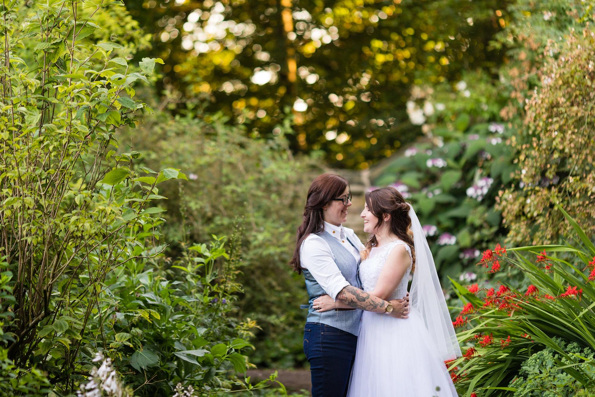 Brides in the garden at East Riddesden Hall