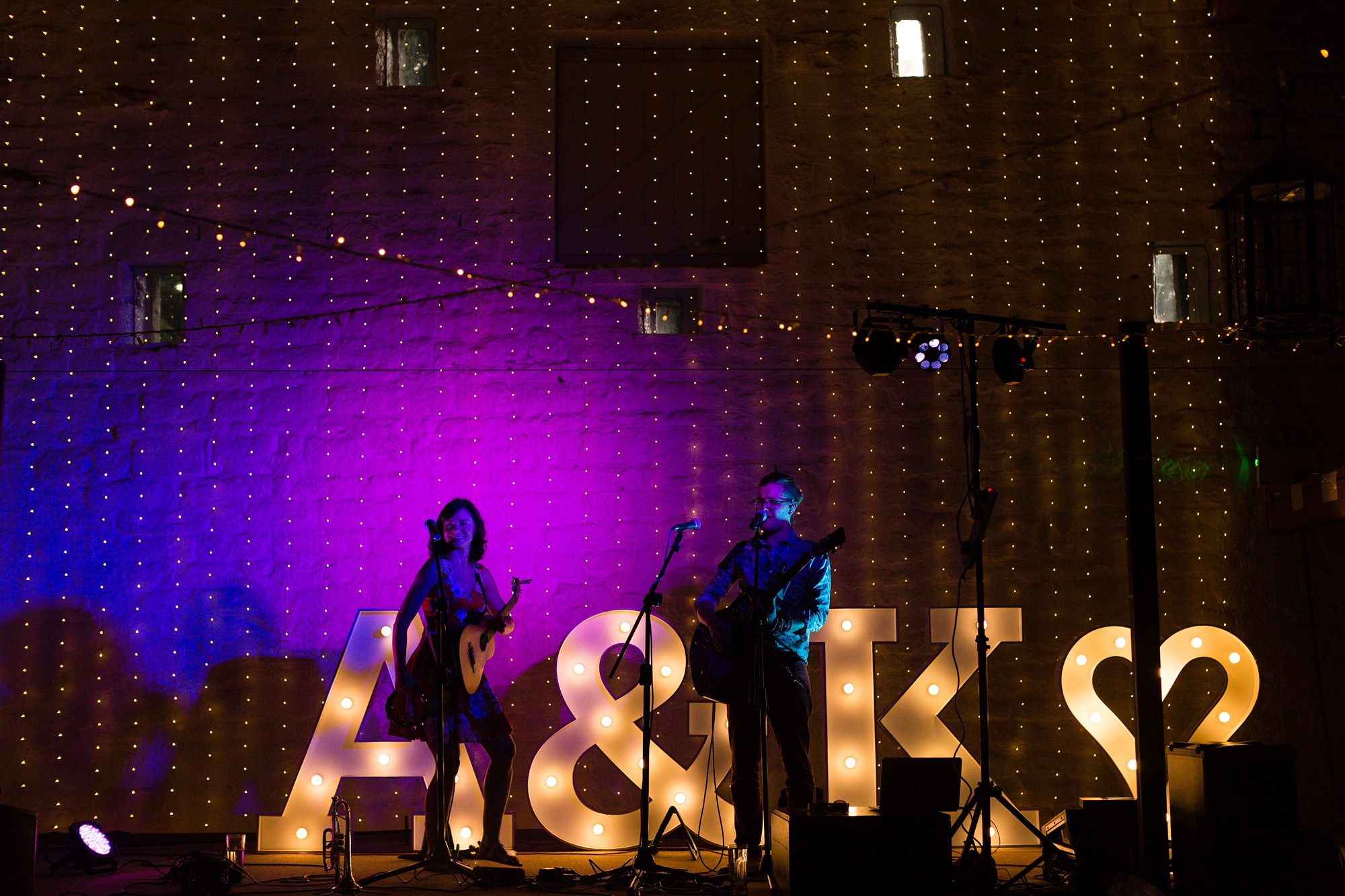 Band playing in colourful light East Riddlesden Hall Wedding Photography