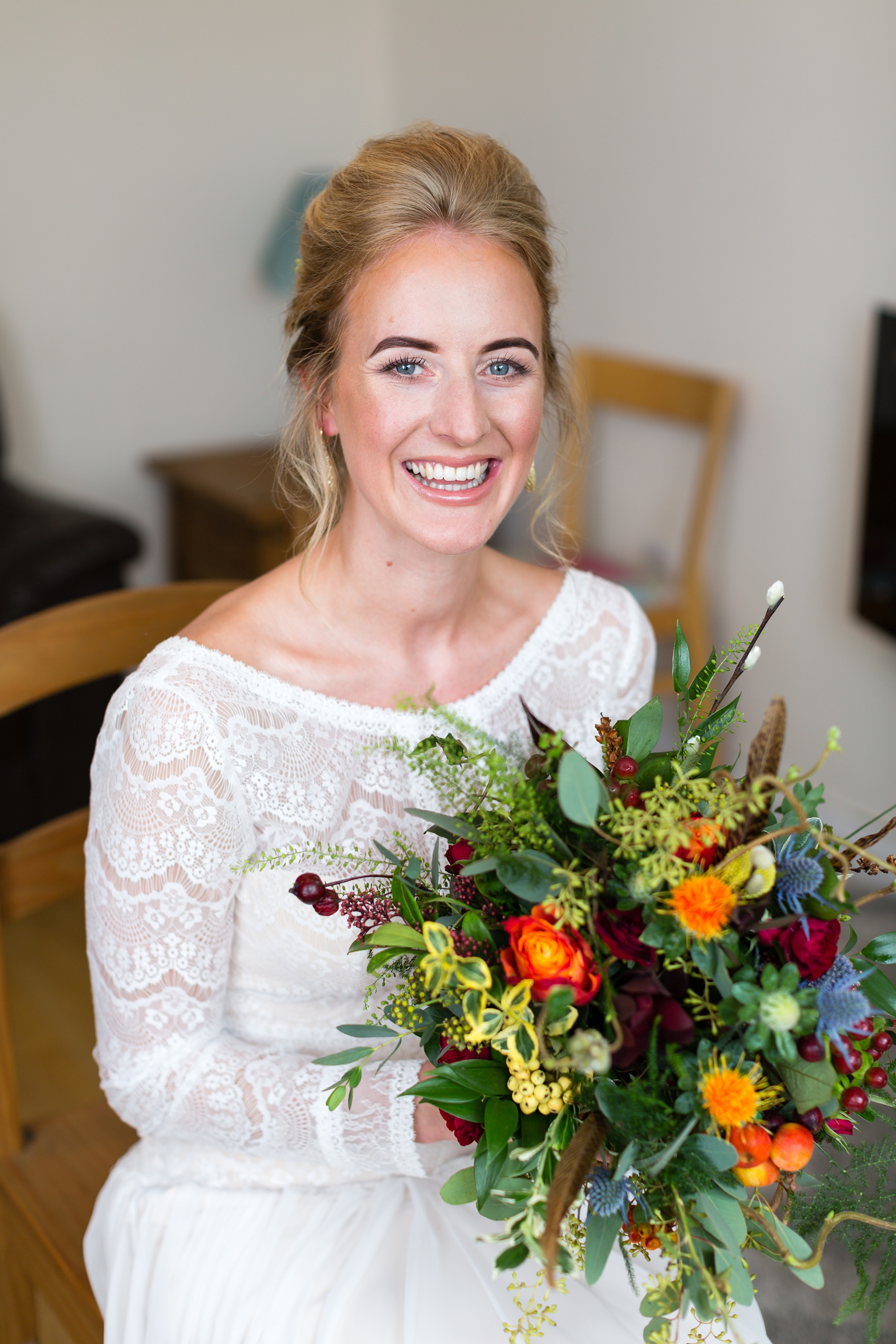 Barmbyfield Barn Wedding Photography bride portrait holding autumnal flowers