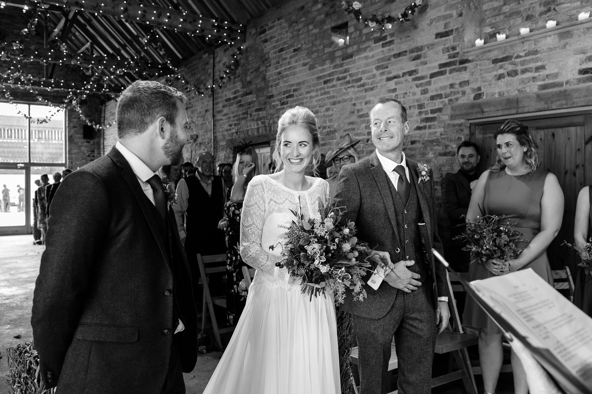 Barmbyfield Barn Wedding Photography bride walks up the aisle and sees groom for first time.