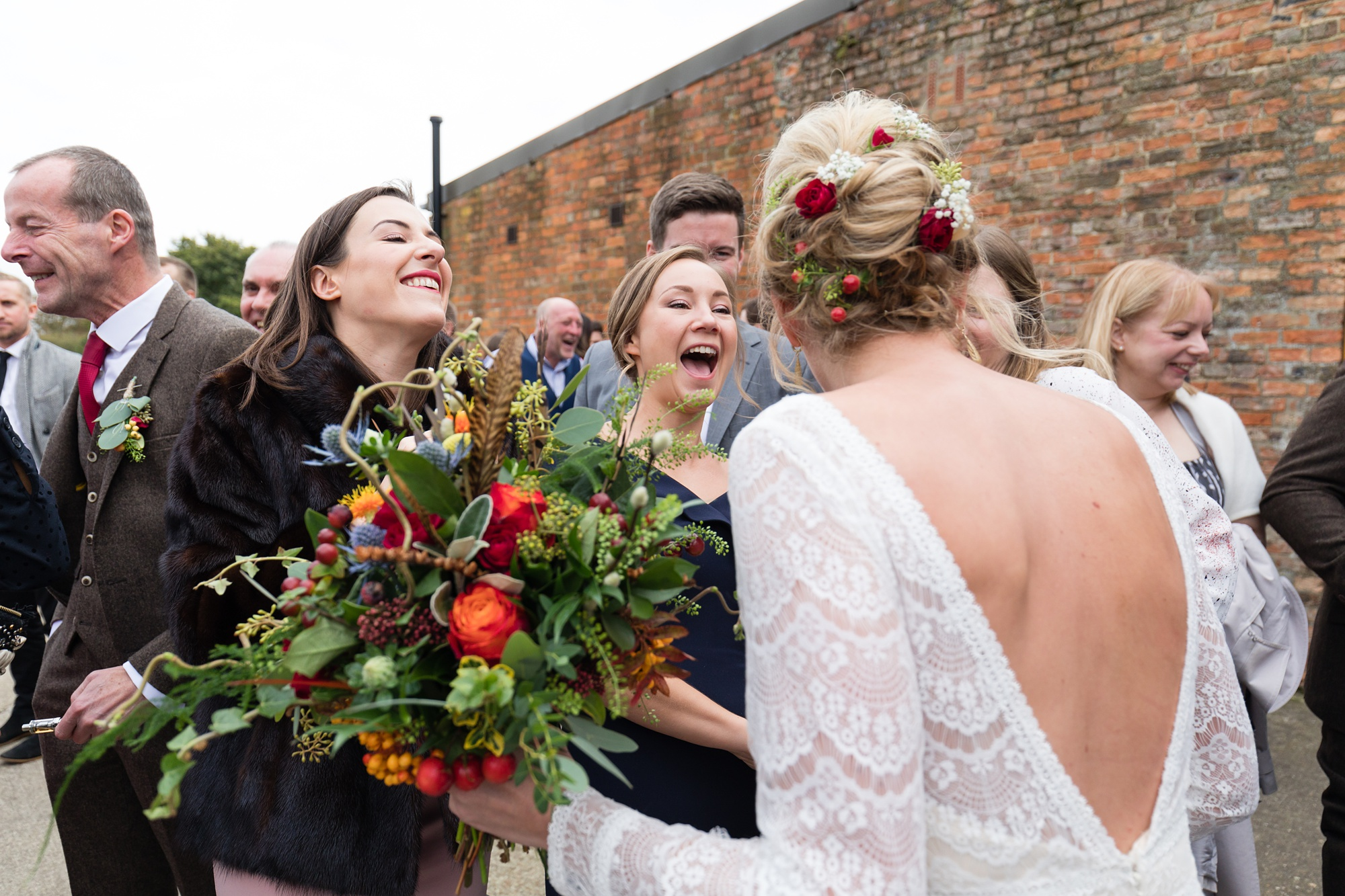 Yorkshire Wedding Photographers guests hugging and saying hello